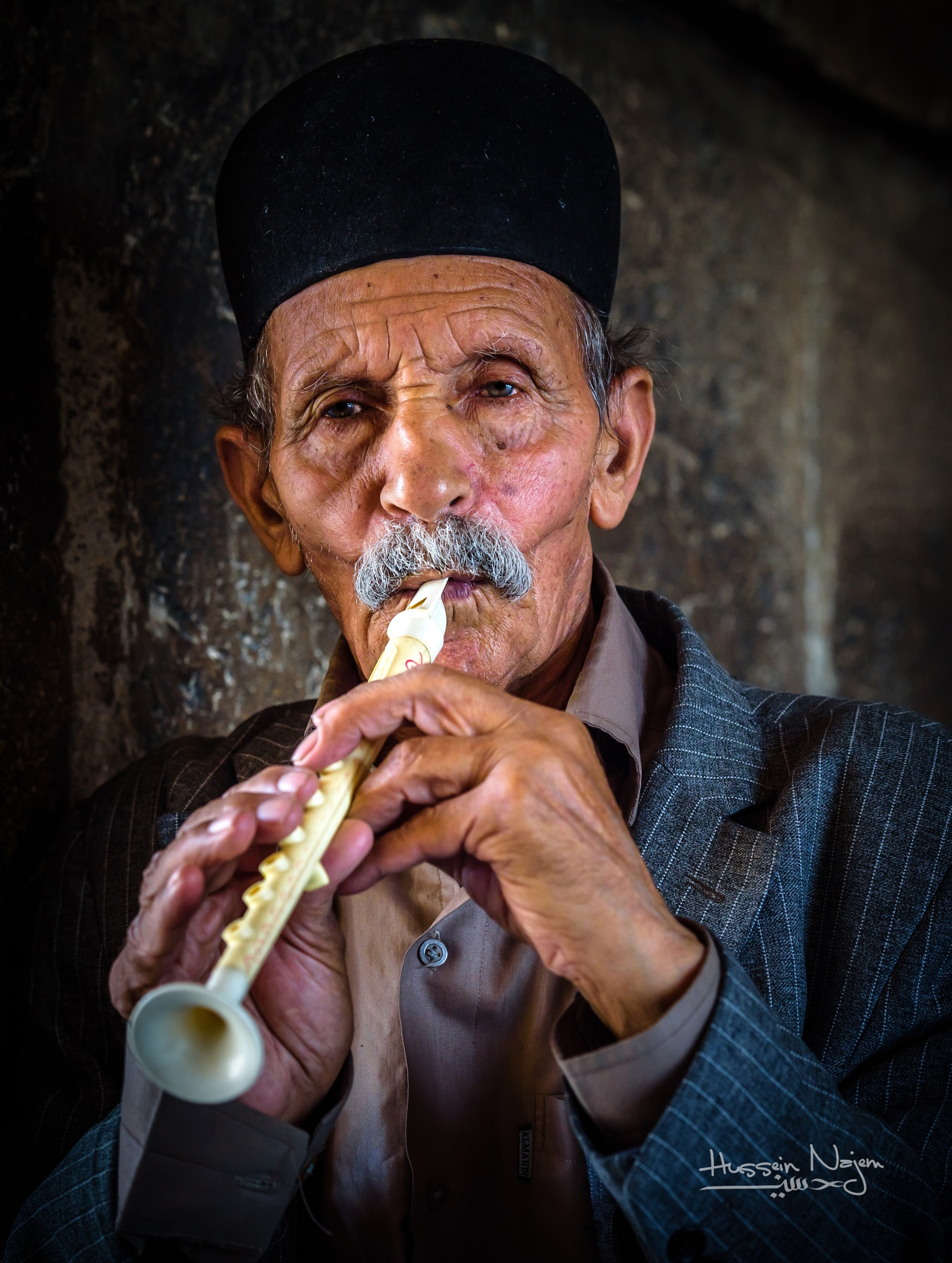 flute player by Hussein Najem