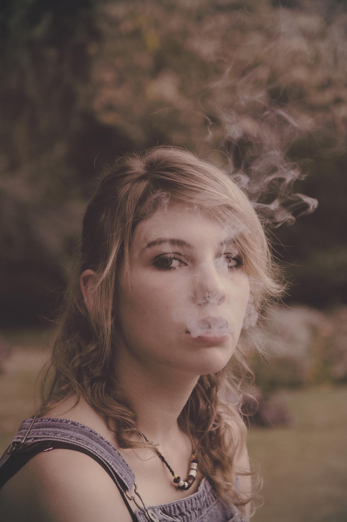 woman smoking by Marie Kri