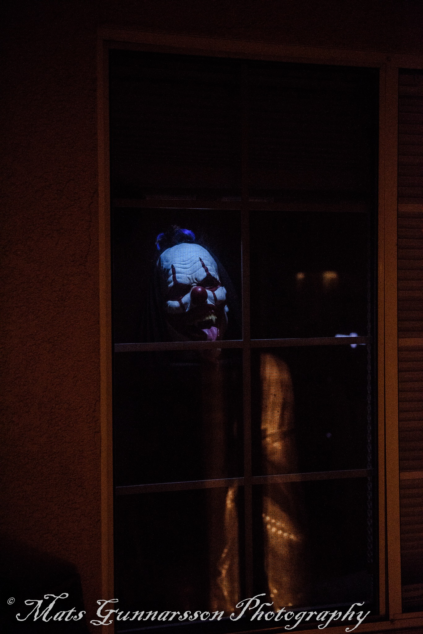 Evil clown in the window by MatsGunnarssonPhotography