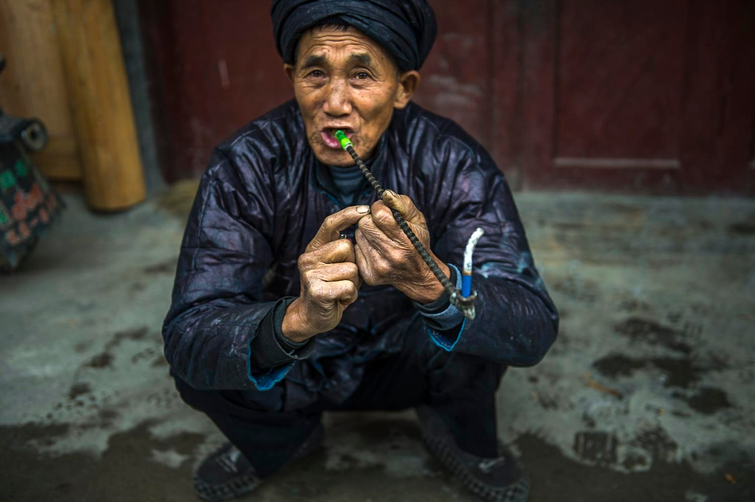 Man Smoking a Long Pipe by Susan Laurie