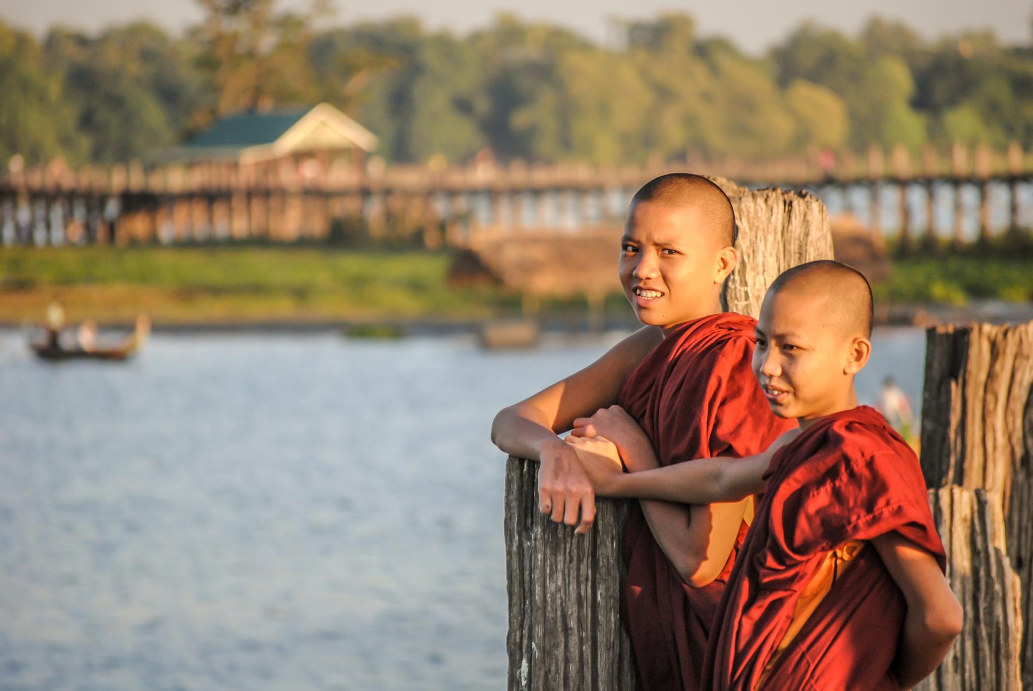 Monks on U Bein Bridge - Myanmar by Chamkhi Jamil