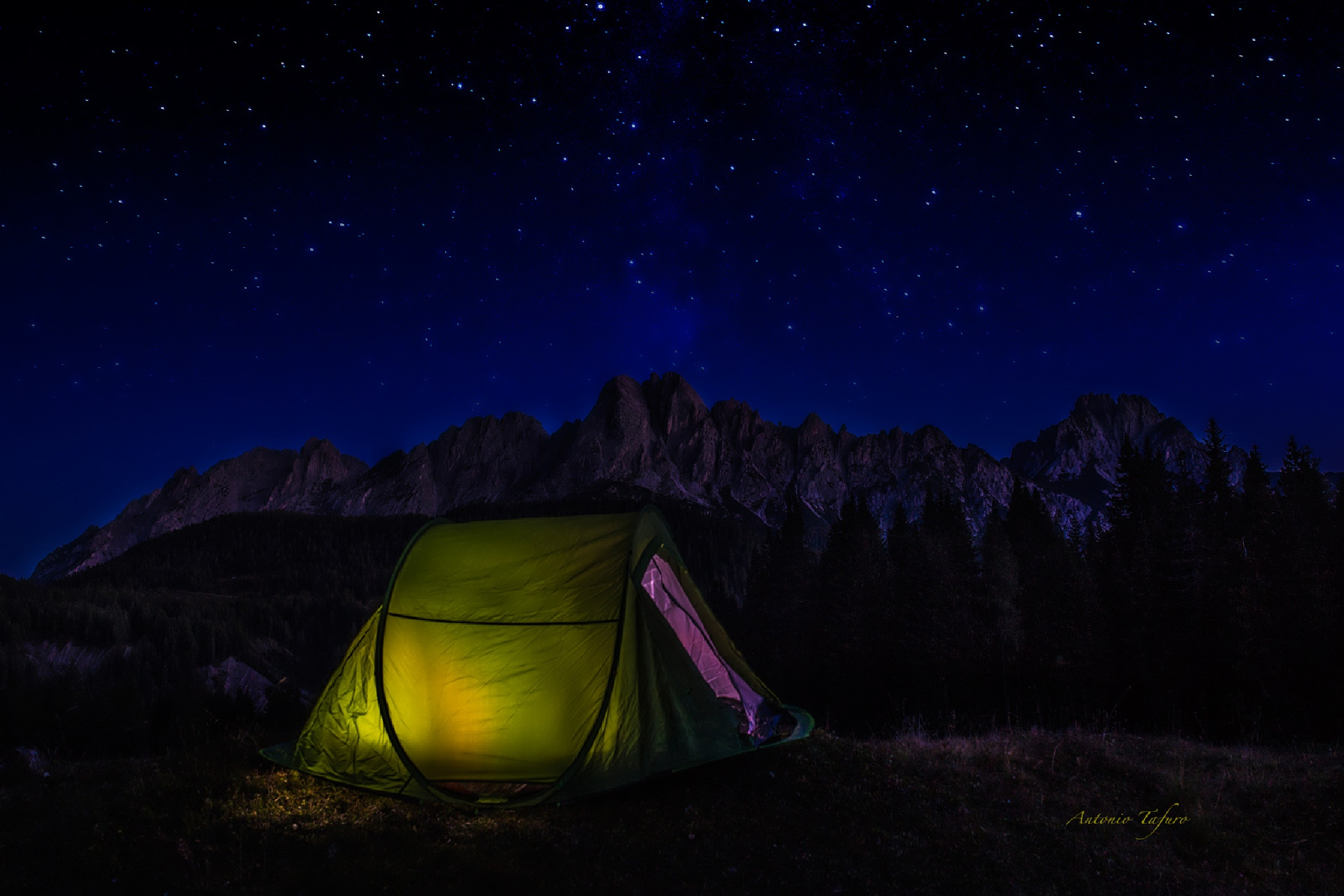 a tent under a sky of stars by Antonio Tafuro