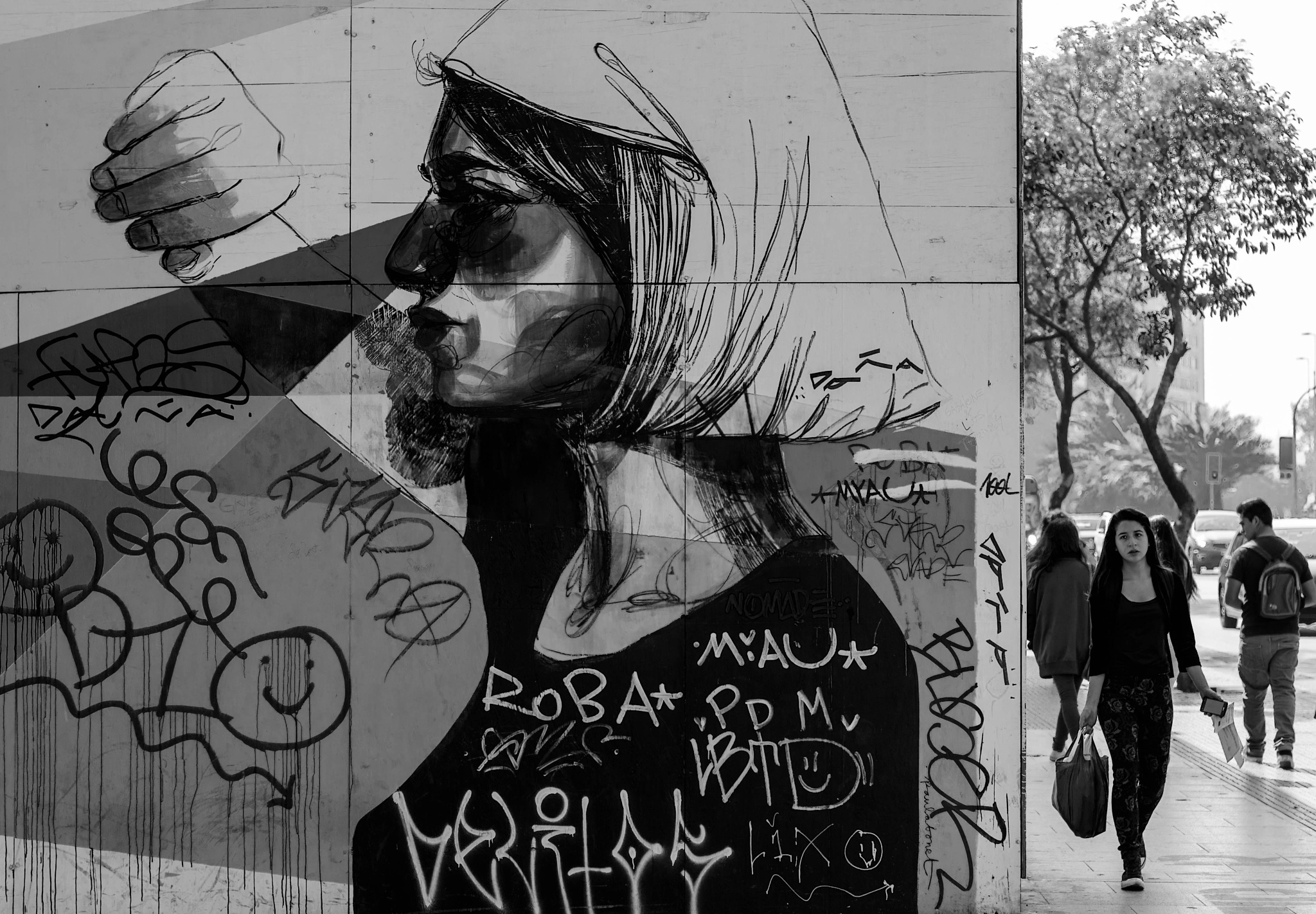 Photo in Street Photography #niunamenos #city #ciudad #santiago #chile #calle #street #streetphotography #people #woman #blackandwhite #monotone #monochrome #graffiti