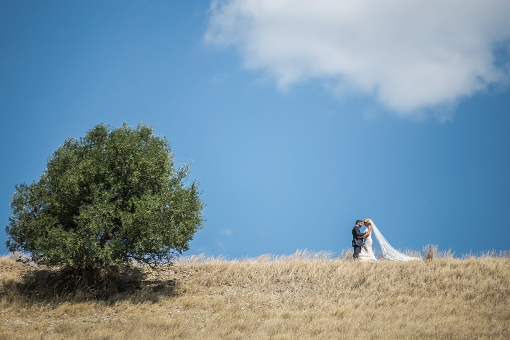 Couple at hill by Christos Aggelidis