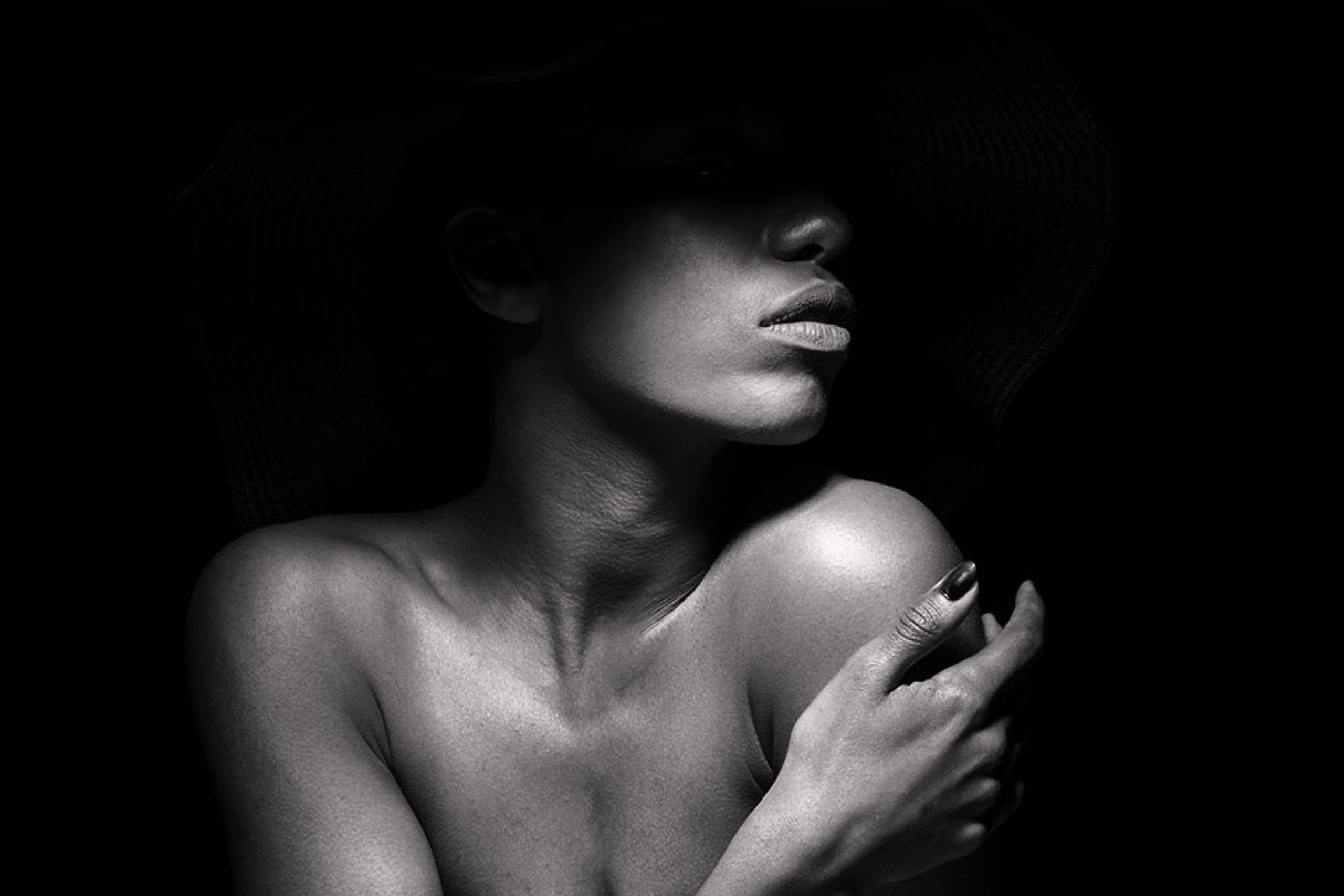 in the shadow of the hat by Krystian Marcin Chrzanowski