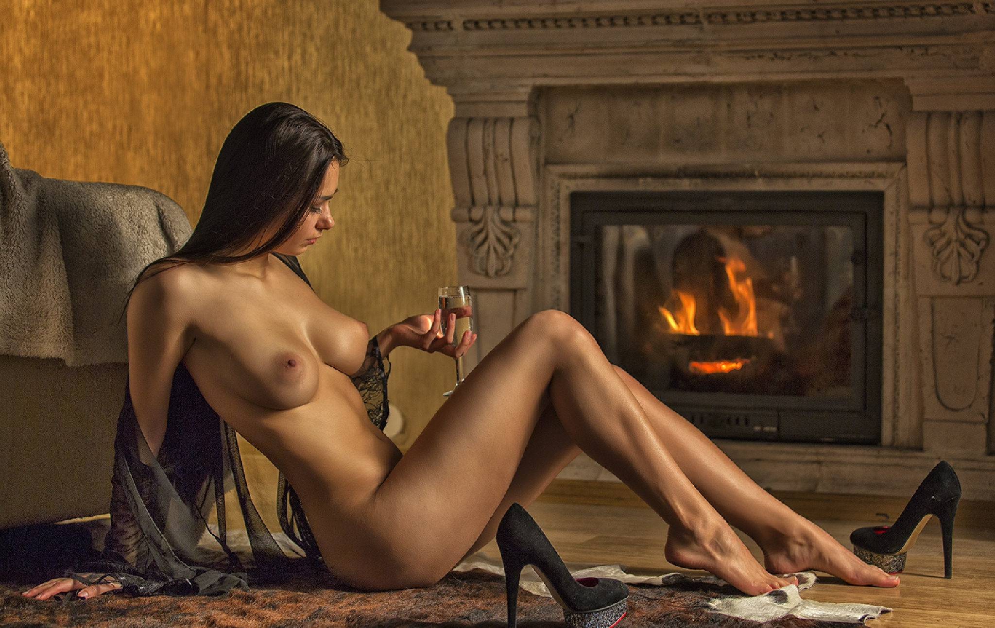 Glass of wine, a fireplace and shoes by Vladimir Larionov