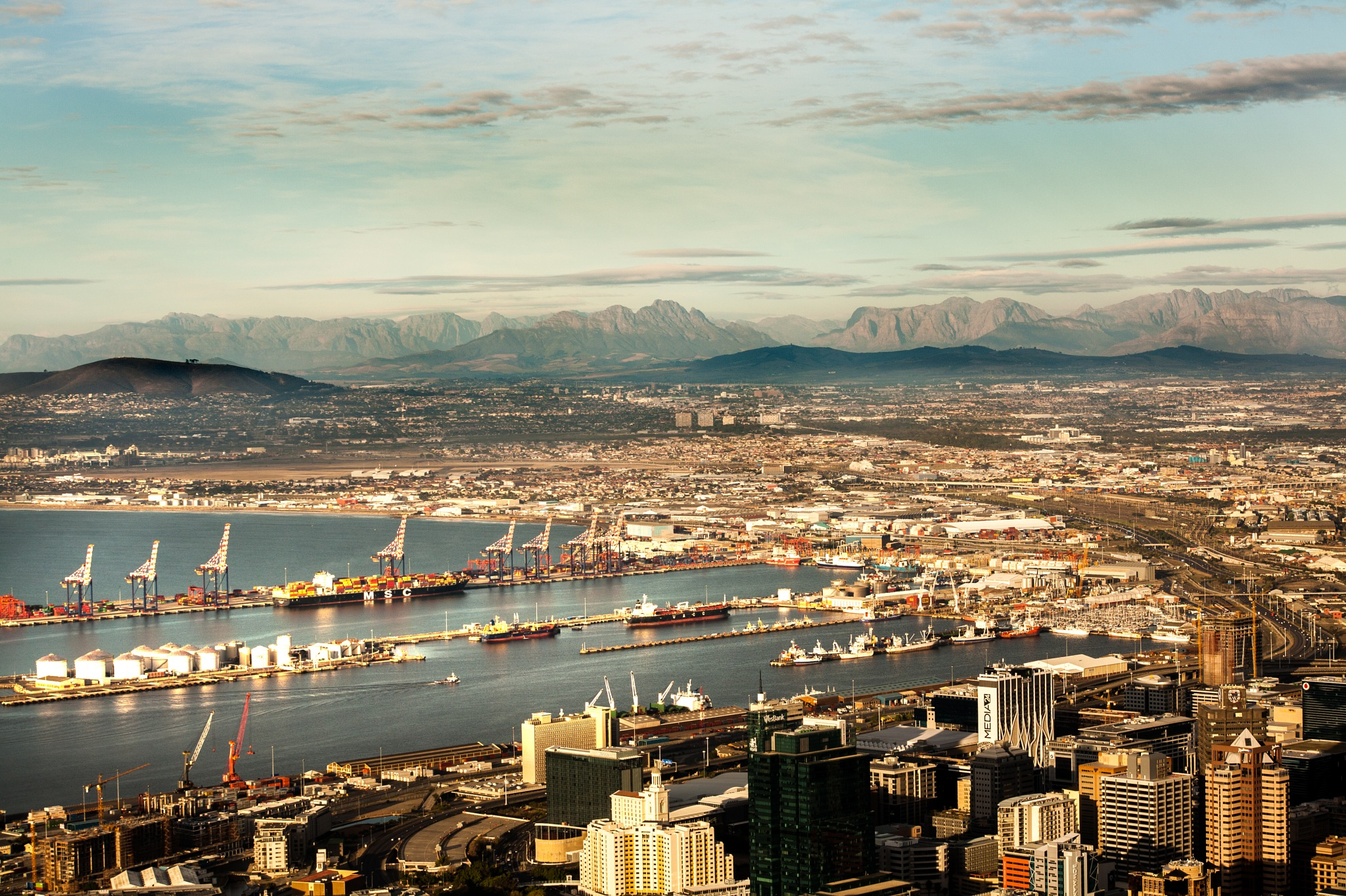 Cape Town harbour with the Stellenbosch mountains in the background by Nauta Piscatorque