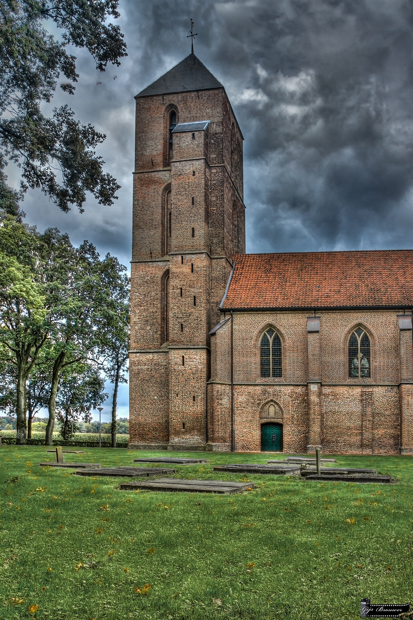 Ancient tombs at the Havelter Church by Gijs Brouwer