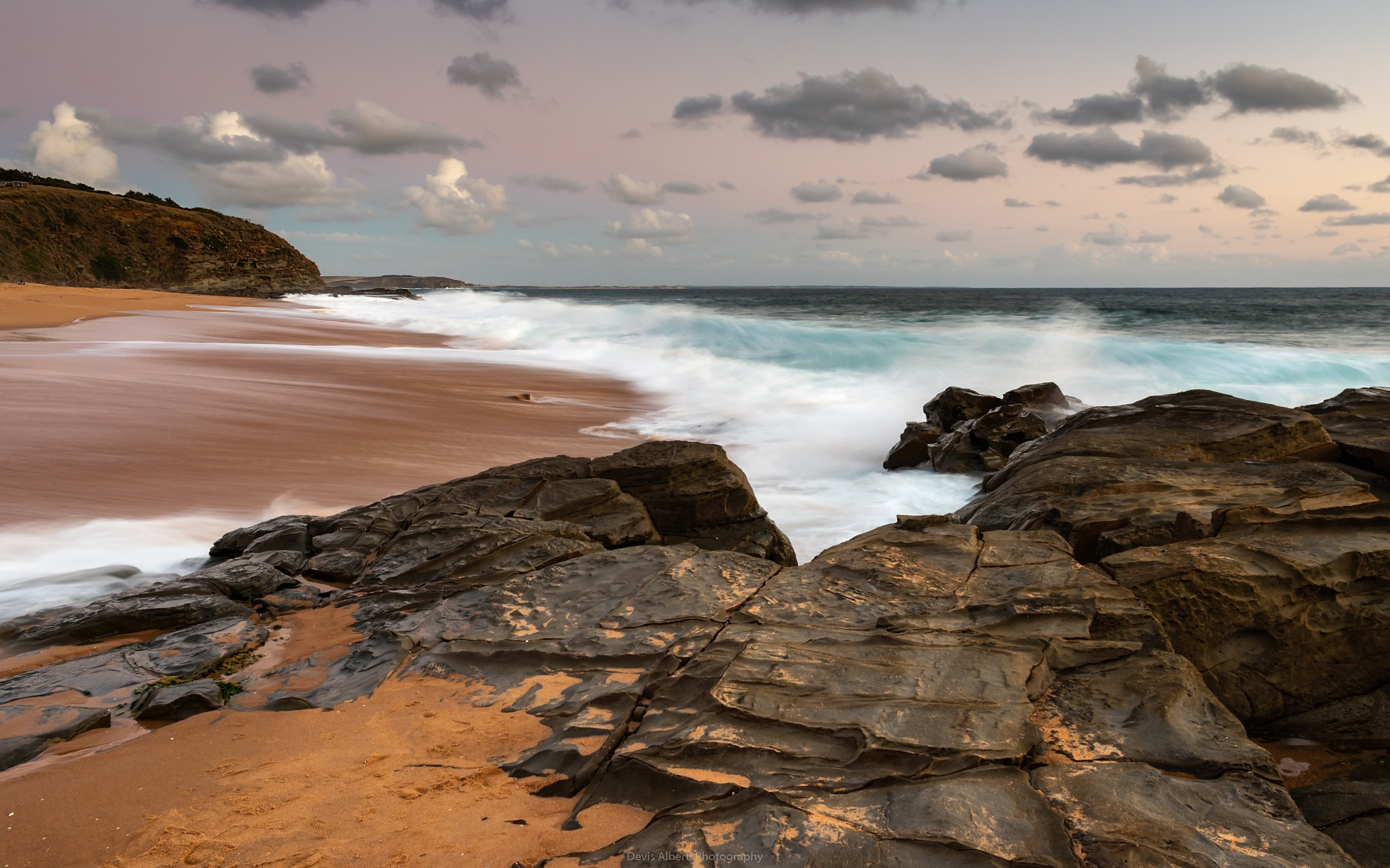 Photo in Sea and Sand #beach #wave #sunset #rocks #clouds #sand