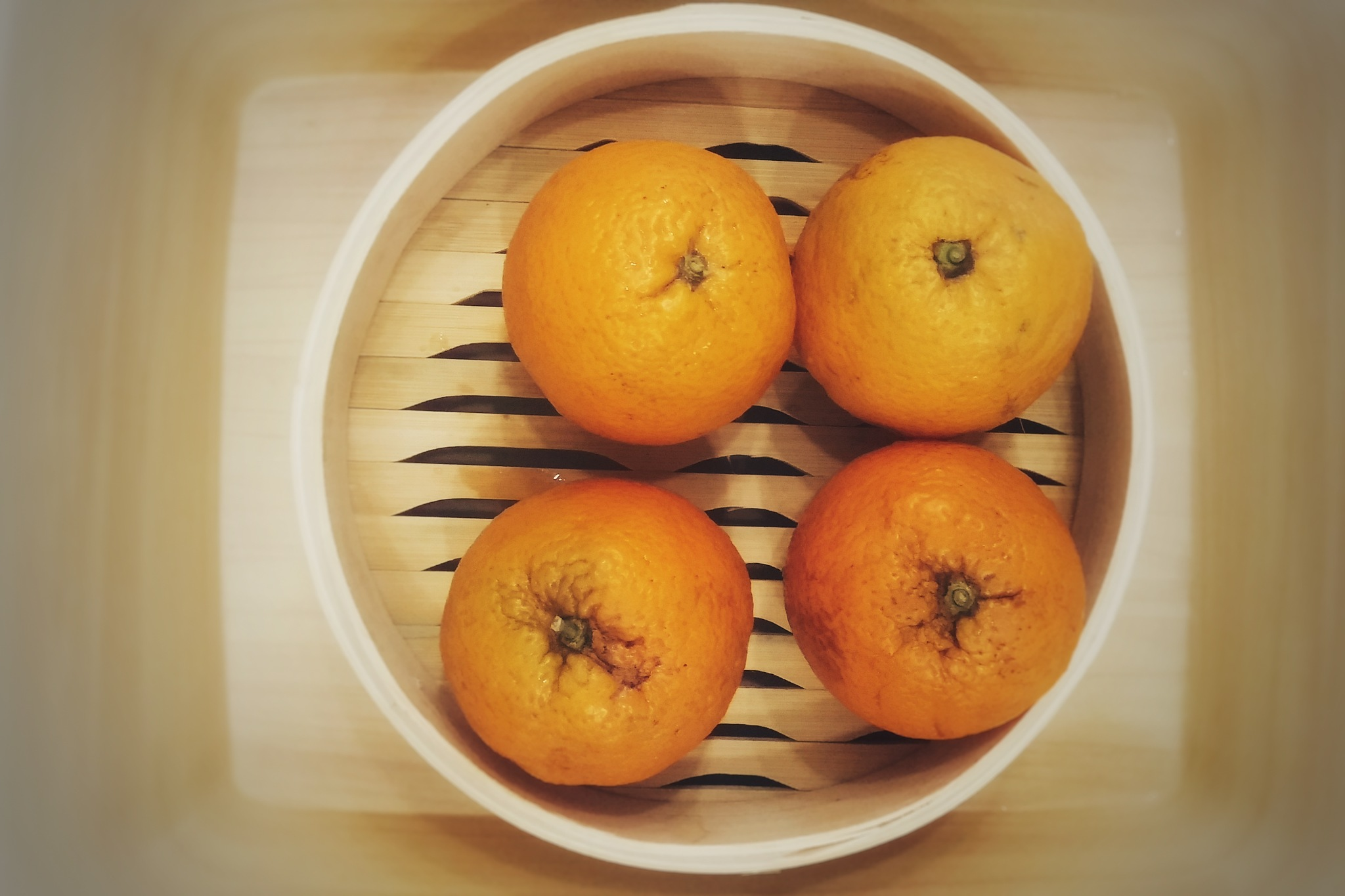 four oranges by Robert Urbaniak