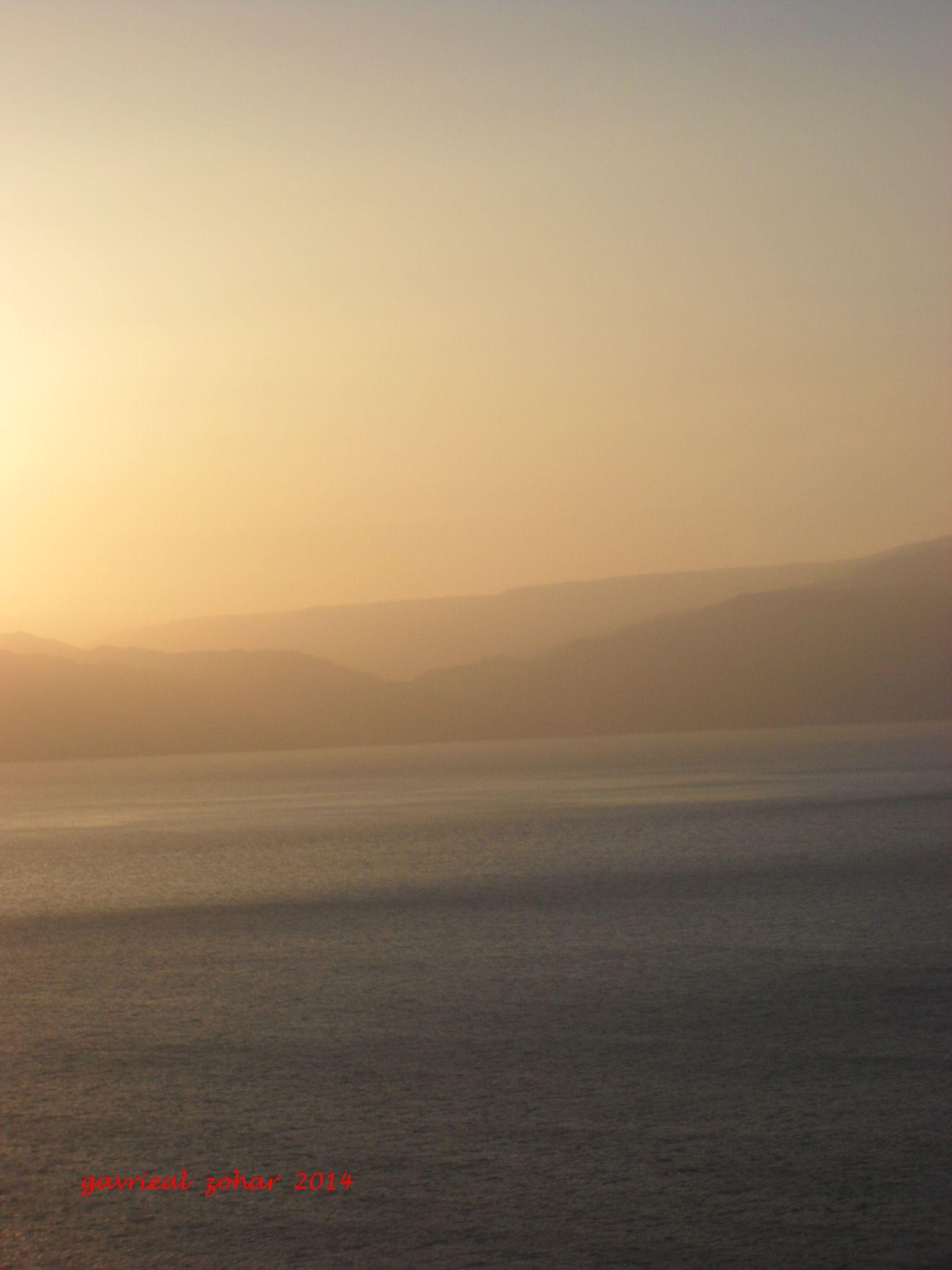 sunrise in the Jordenyen side of the dead sea by gavriealzohar