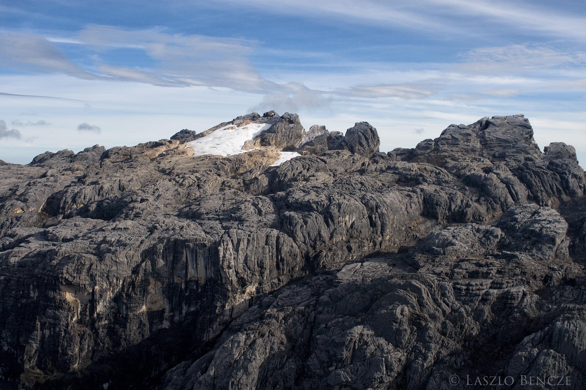 Glacier Near Grasberg Mine by Laszlo Bencze