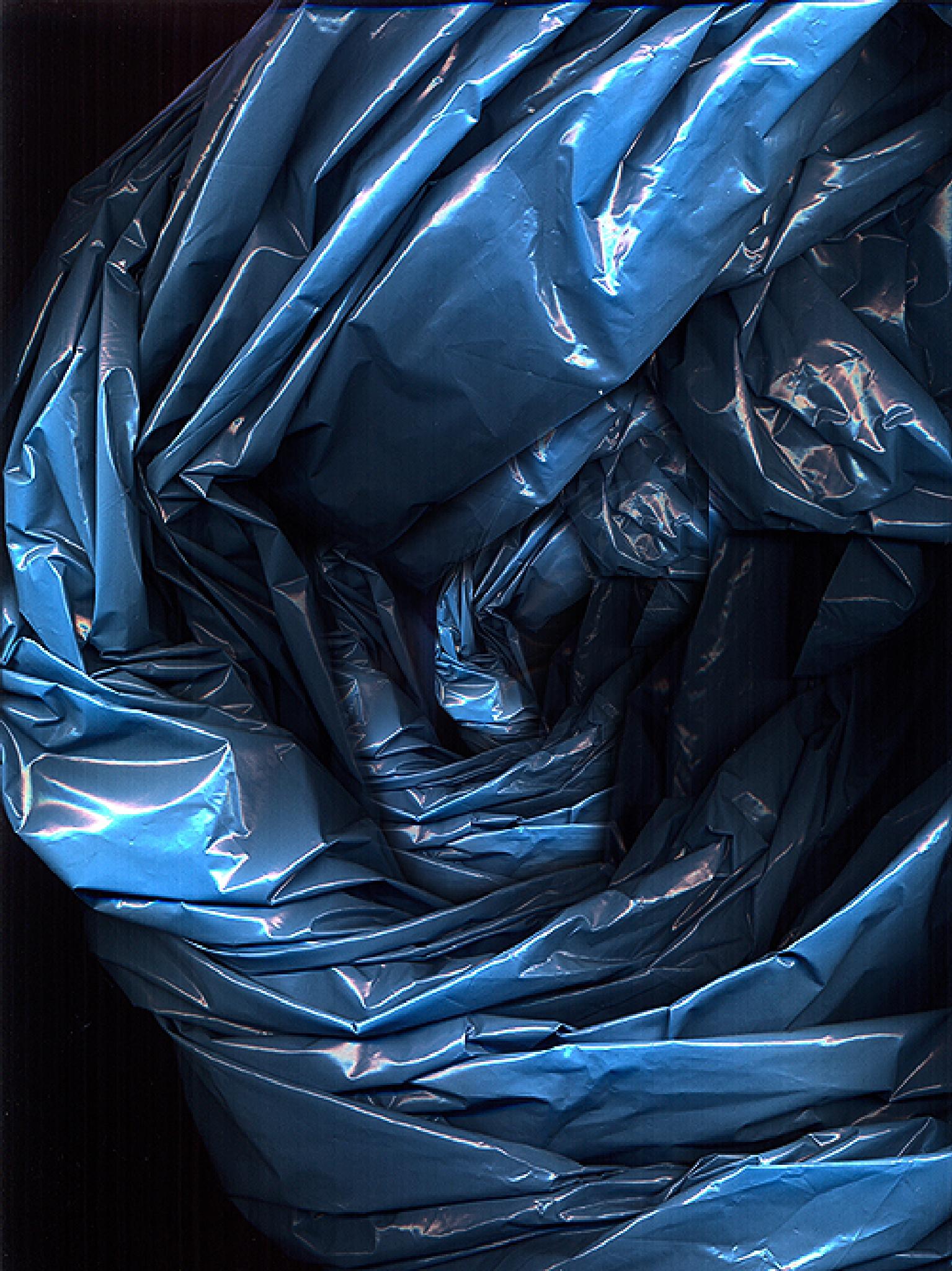 Blue plastic bag by Gernot Schwarz