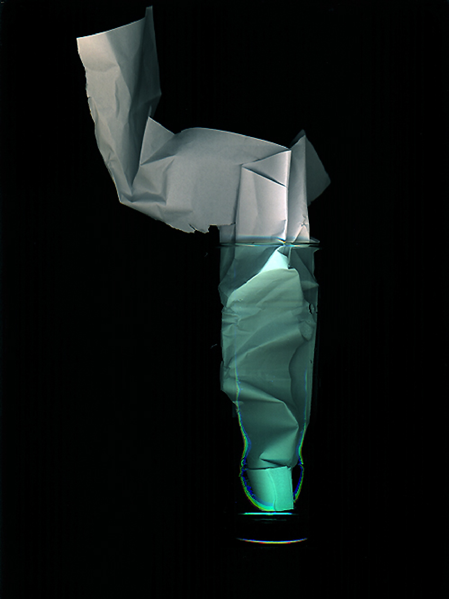 Glass with paper by Gernot Schwarz