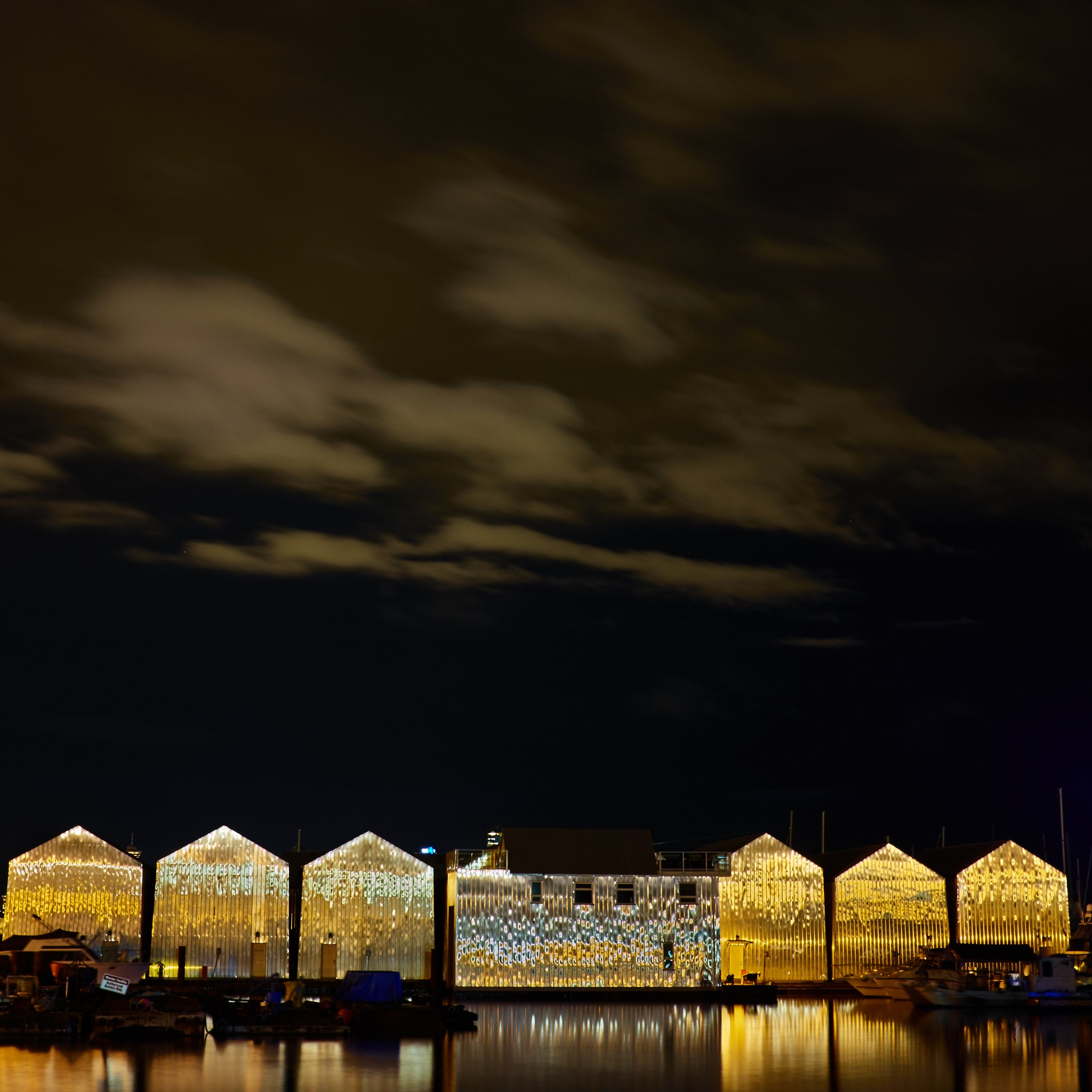 Boathouses at night by Greg Mullaly