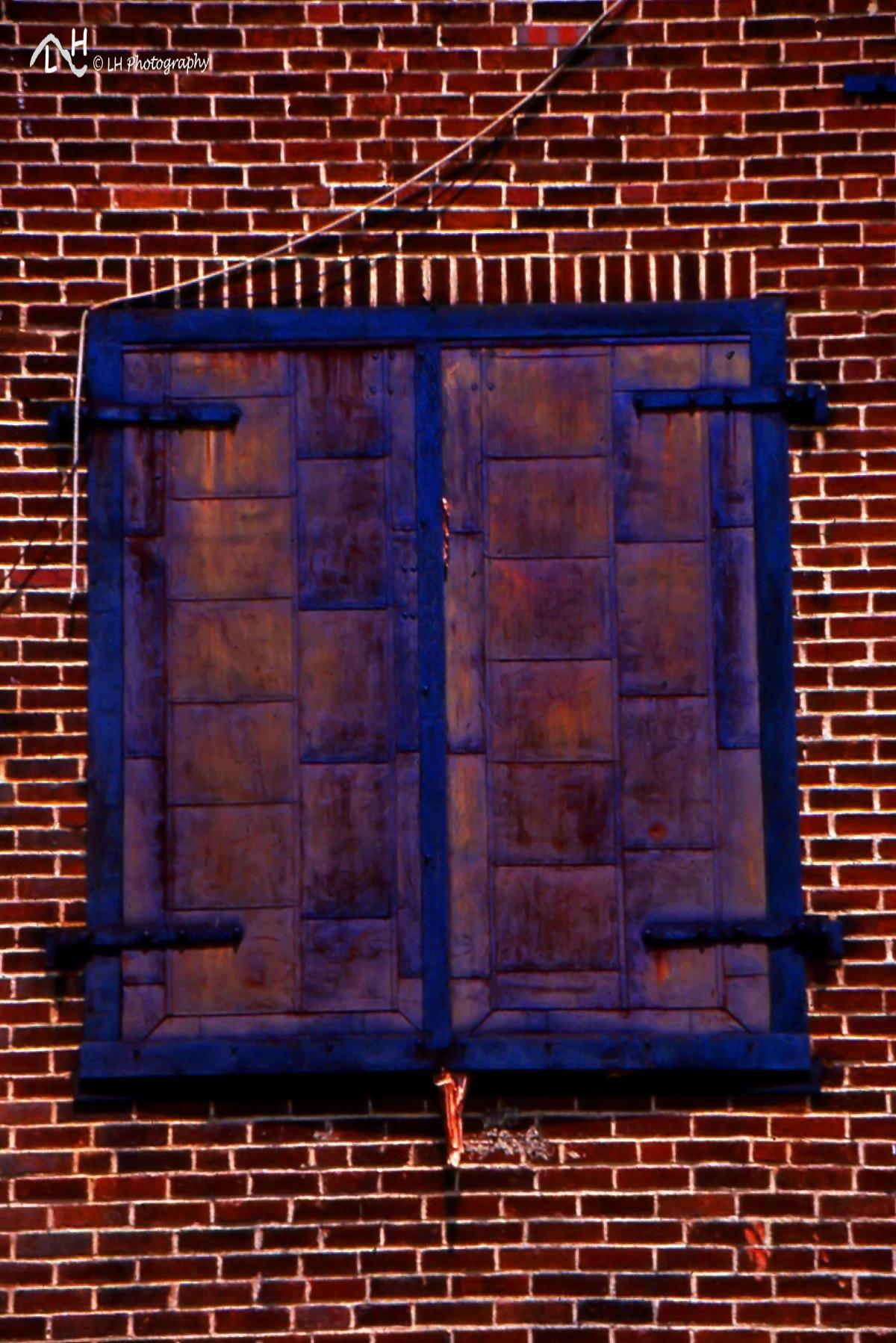 Rusty doors by Laurie Heupel