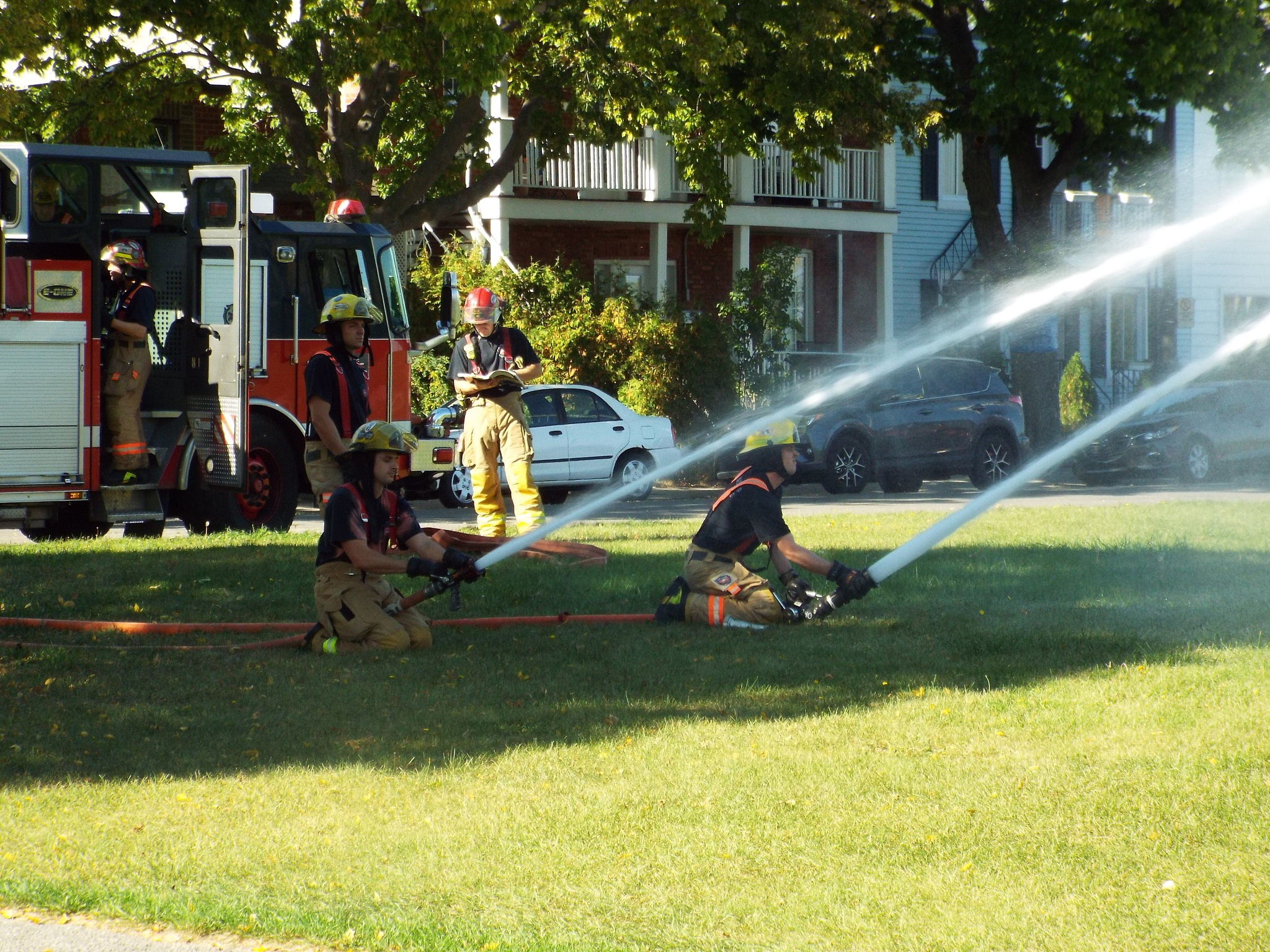 firemen testing equipement by Nicole Bergeron