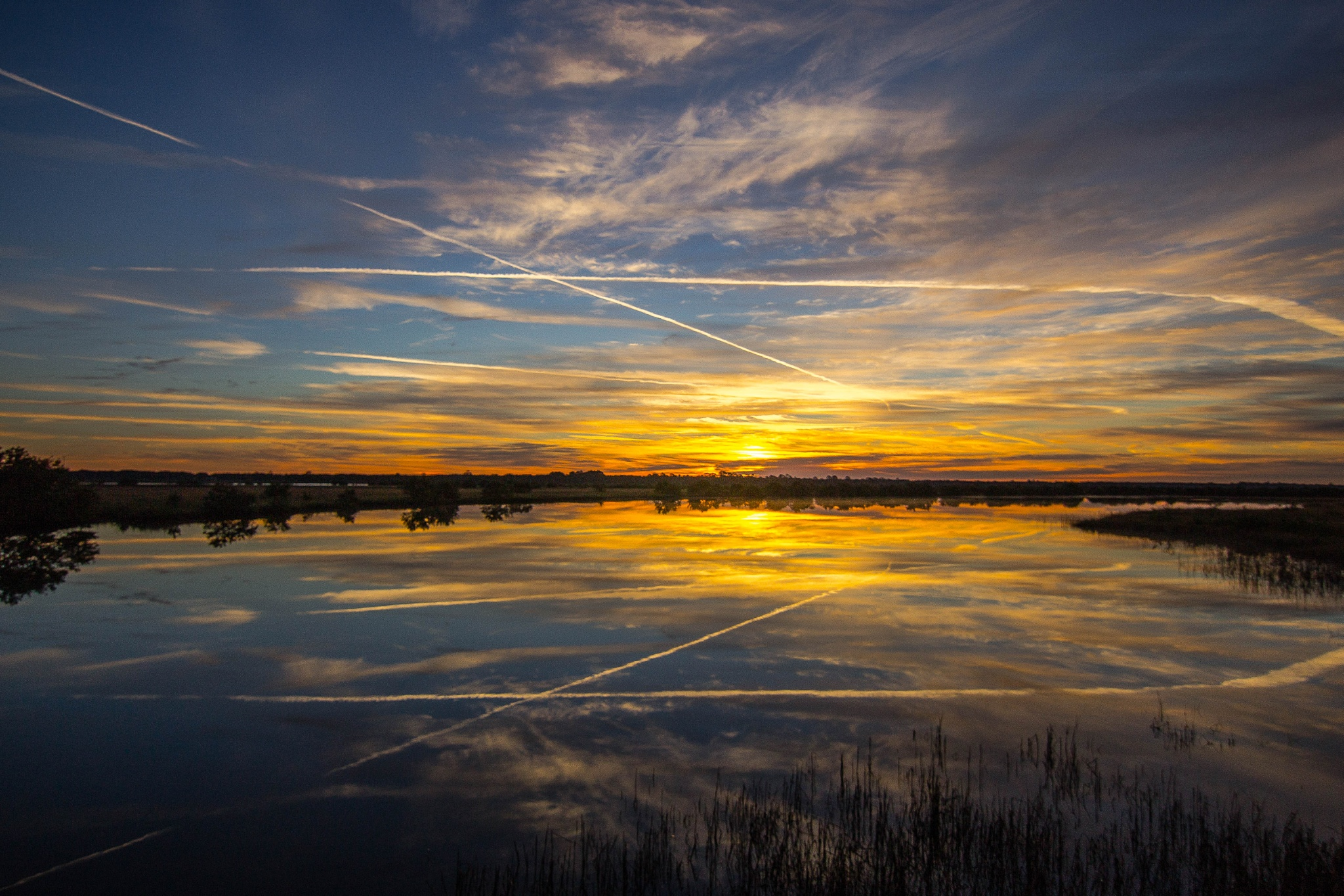 Vapor Trails In The Sky And On The Water by Peter Cavaliere
