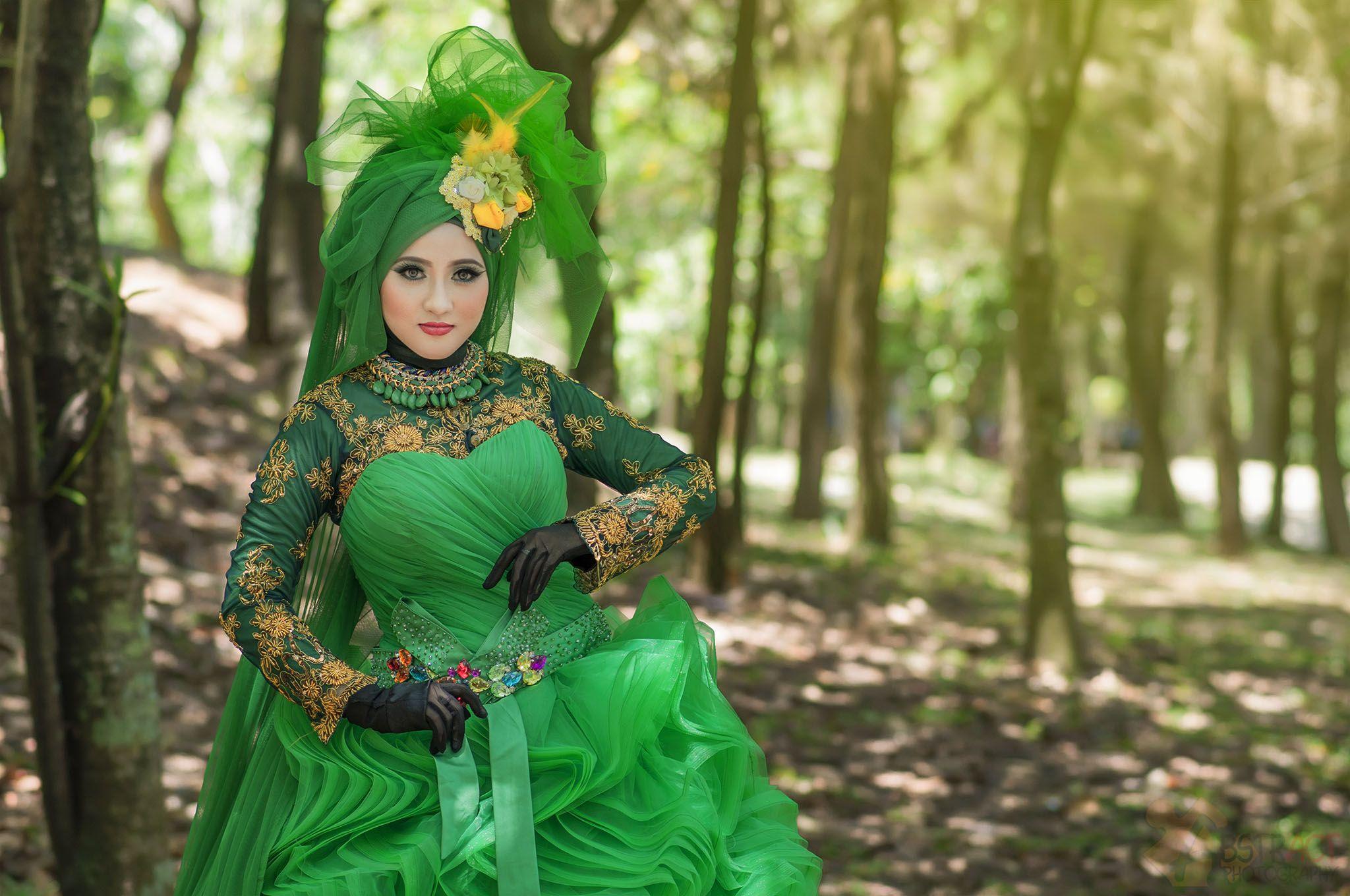 Green hijab gowns by Anggit Priyandani