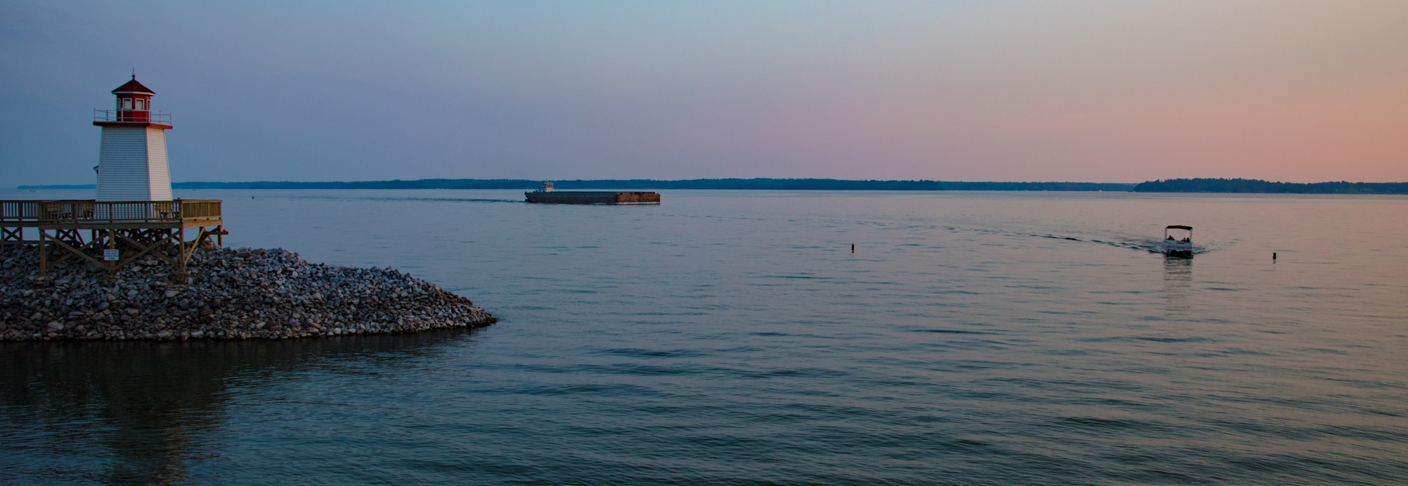 Lighthouse, boat and barge by Neels deConing