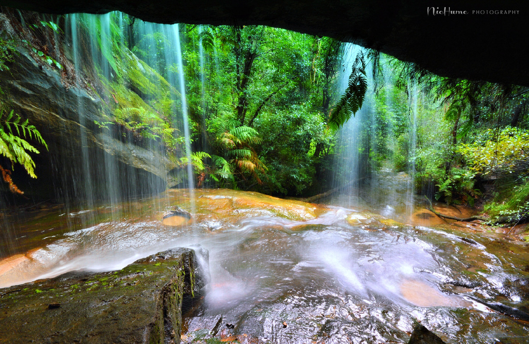 Behind the waterfall by nichumephotography