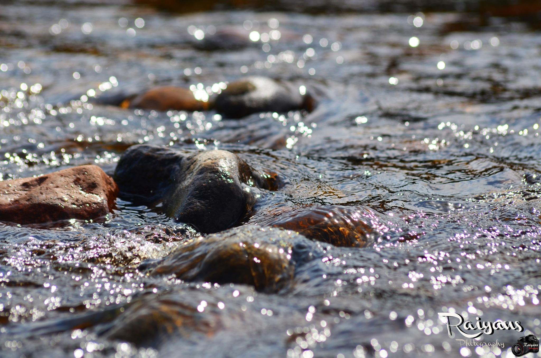 River Stones by Raïyan Fahïm