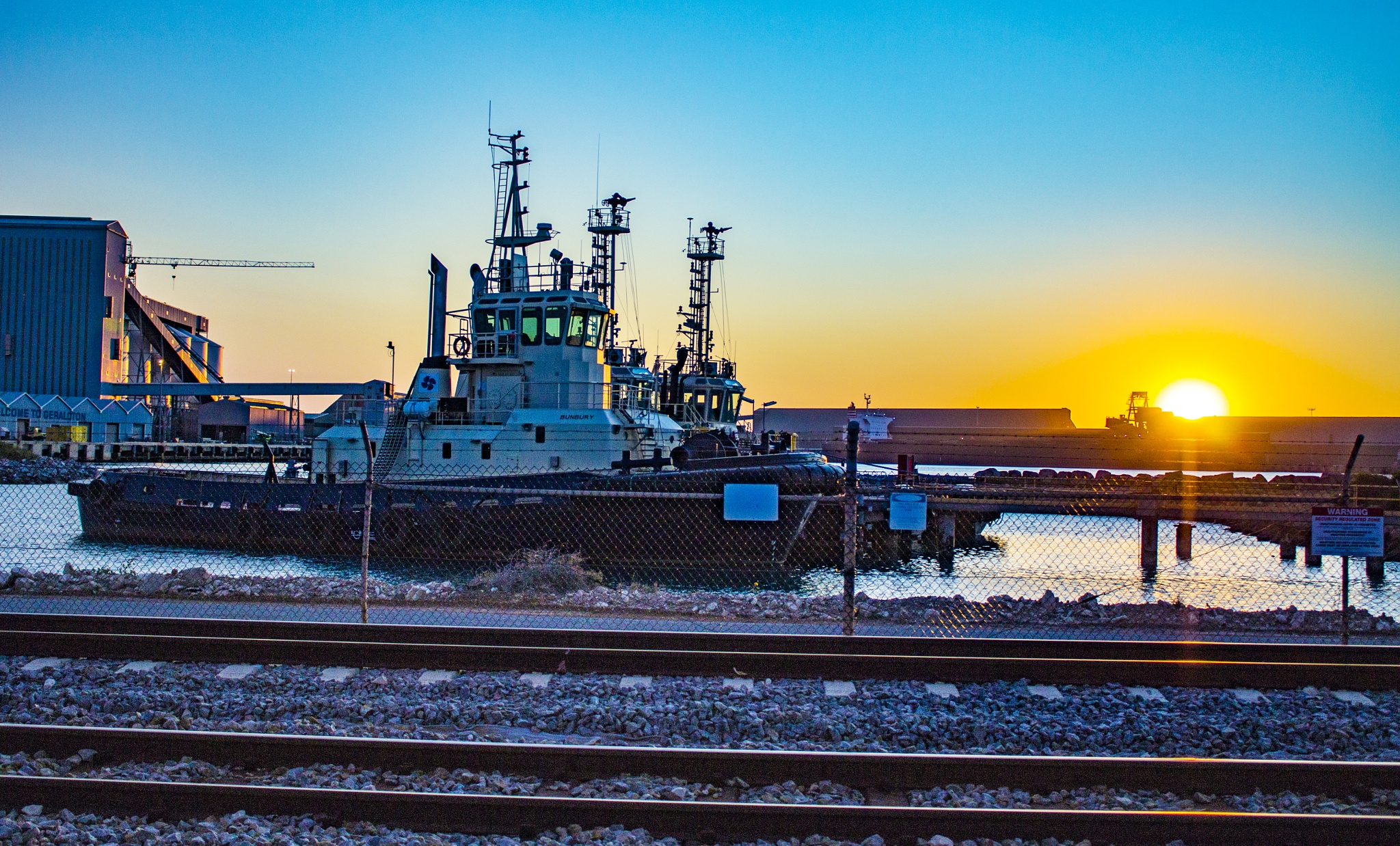 Sunset at the port by Colin Sherman