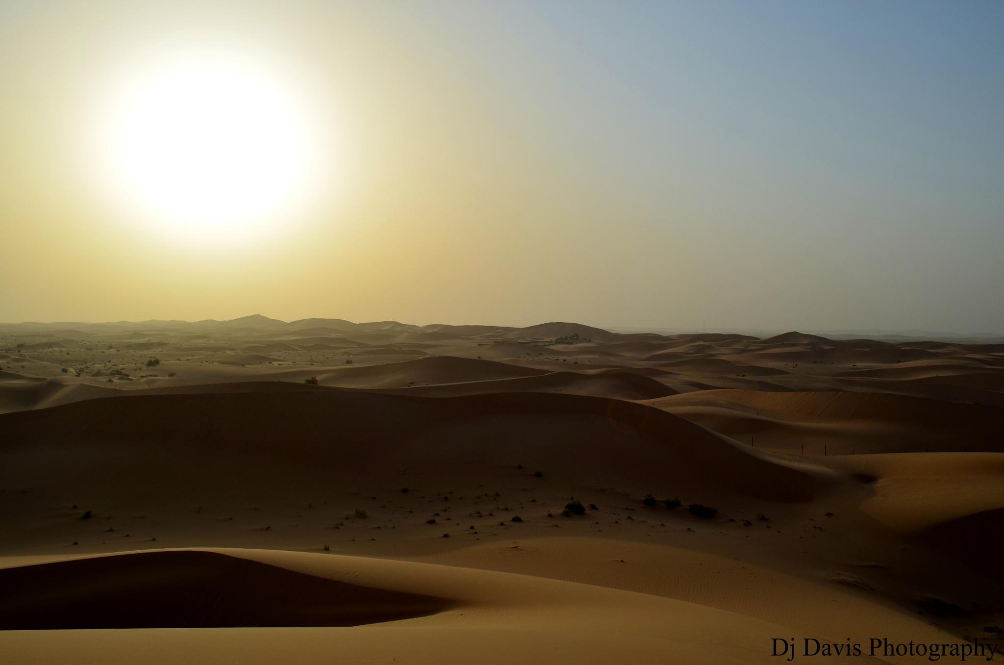 Abu Dhabi desert sunset by D.j. Davis