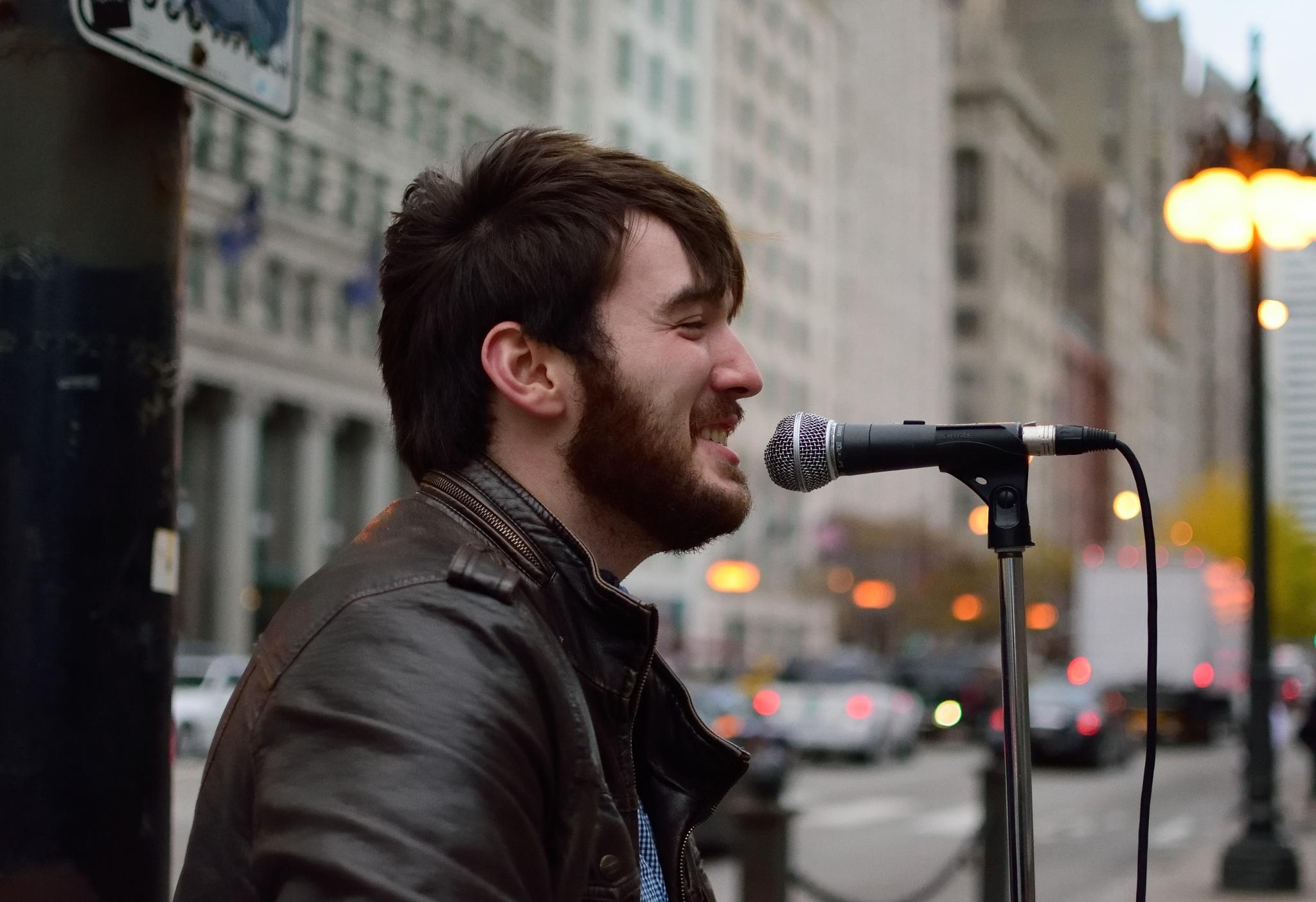 Singer/Musician on Michigan Avenue by Orlando Fonseca