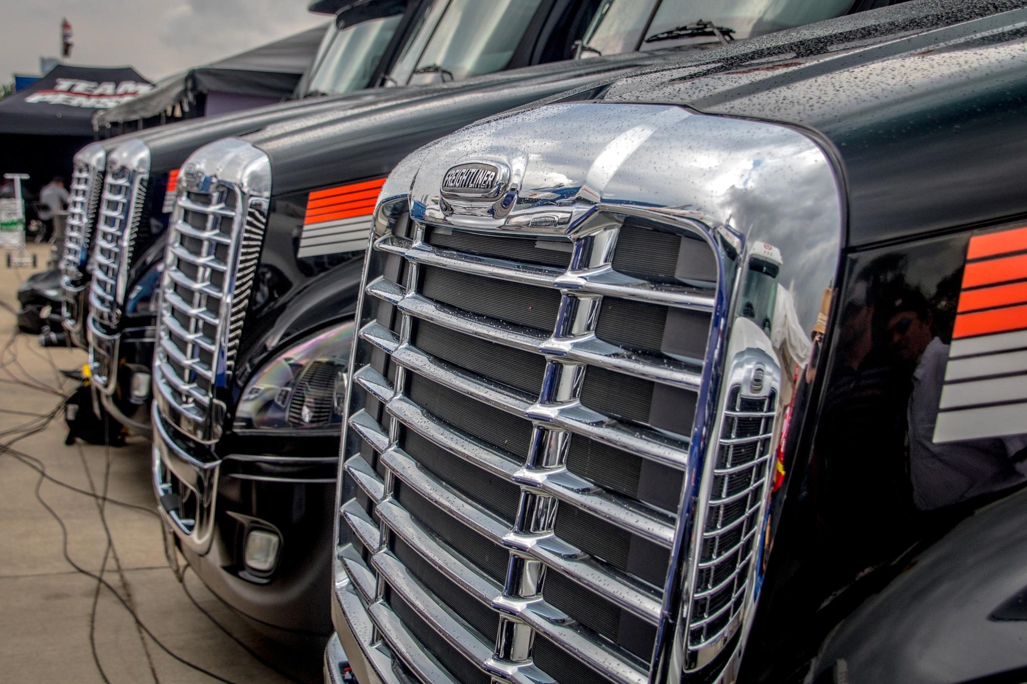 Team trucks lined up. by Gnewsom324