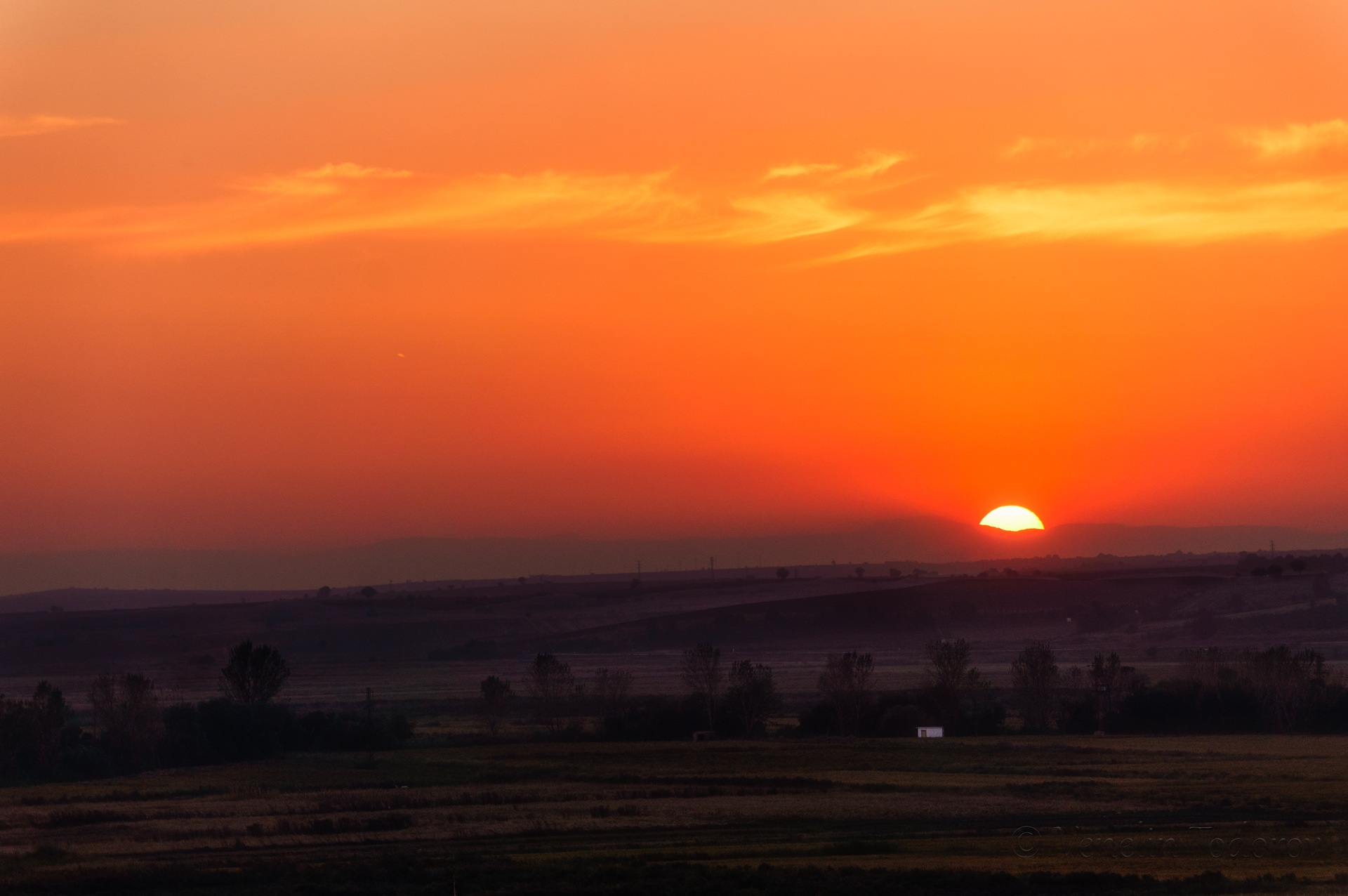 Sunset over the fields by Venelin Todorov