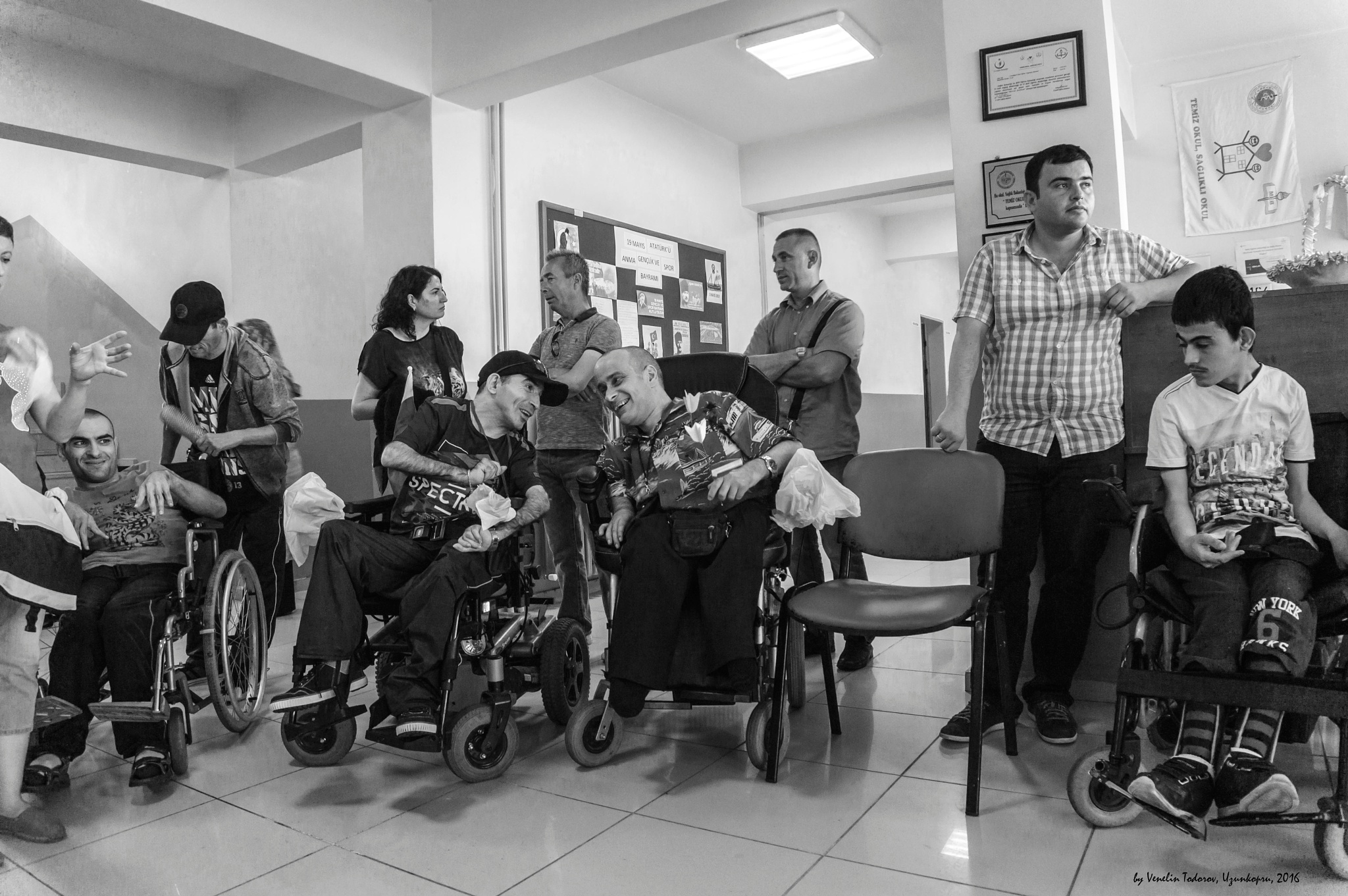 Photo in Journalism #friends #people #with #specific #needs #wheelchairs #meeting #b&w