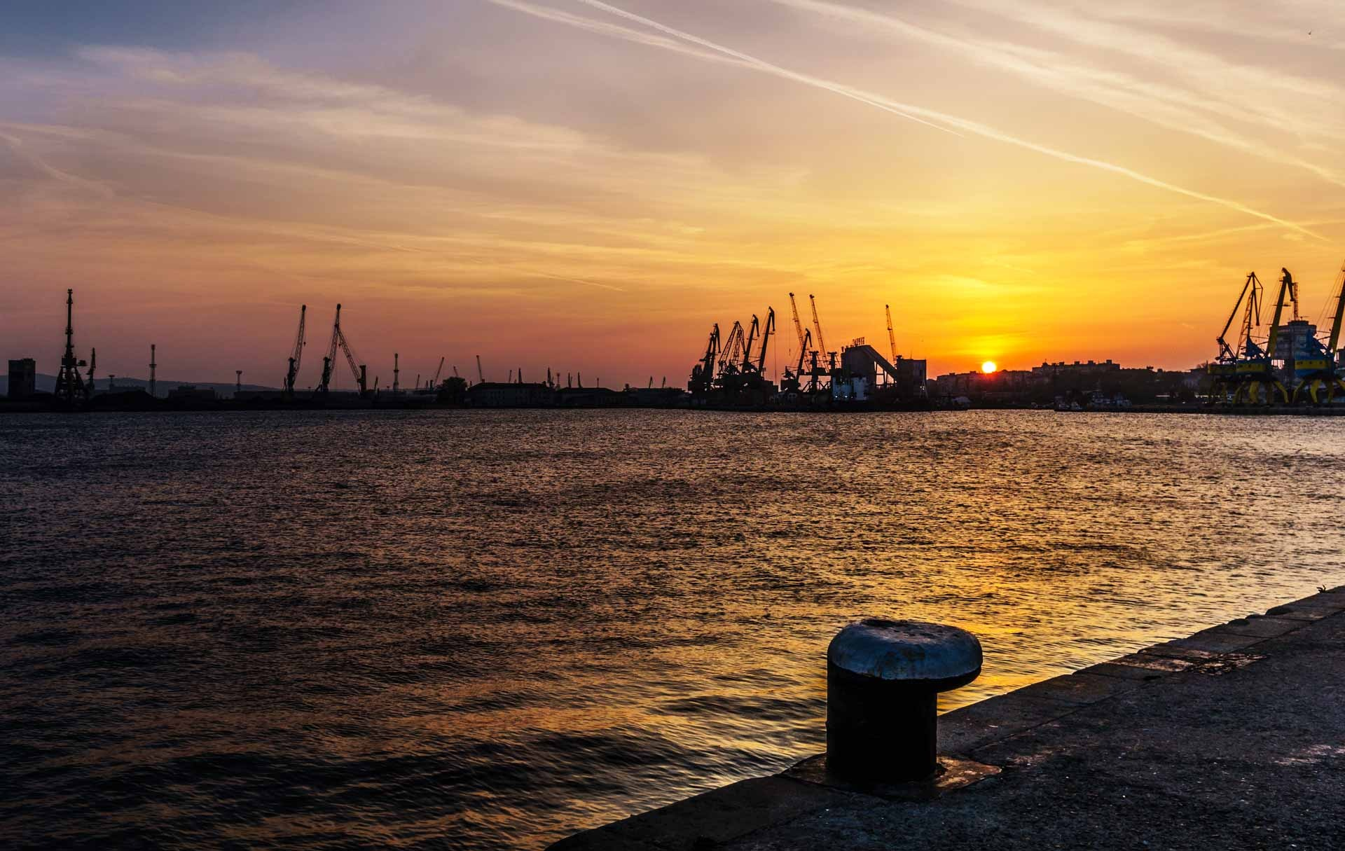 Sunset above the port by Venelin Todorov
