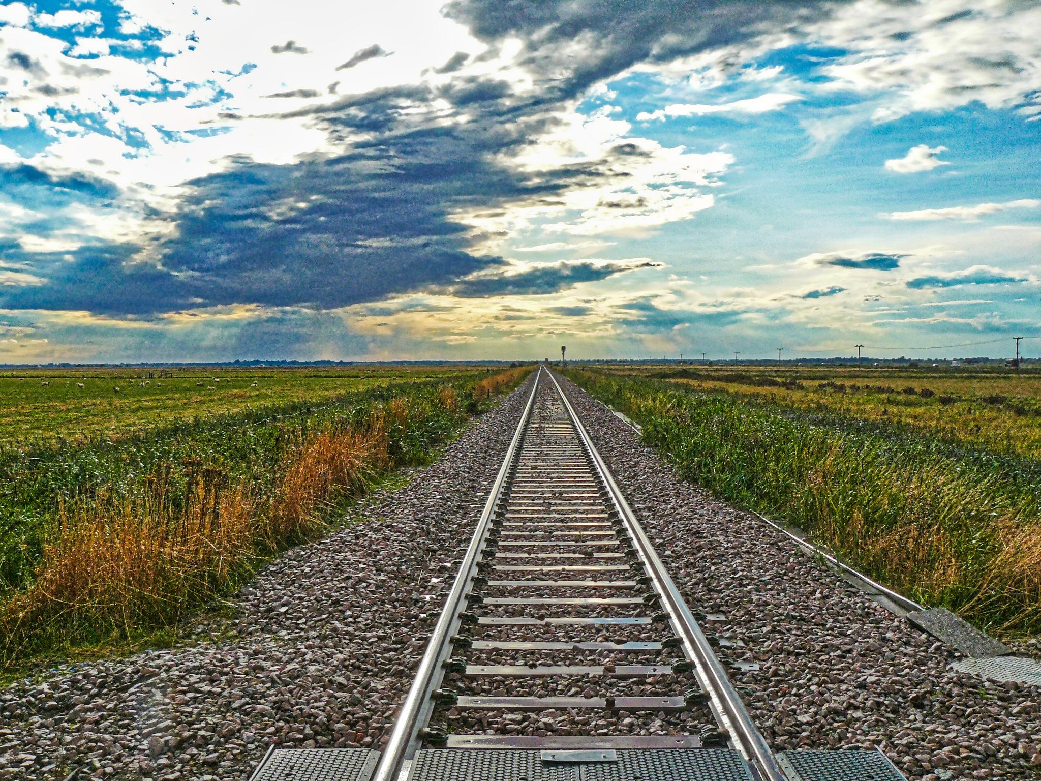 Distant shower by rail by AJ Yakstrangler Andy Jamieson