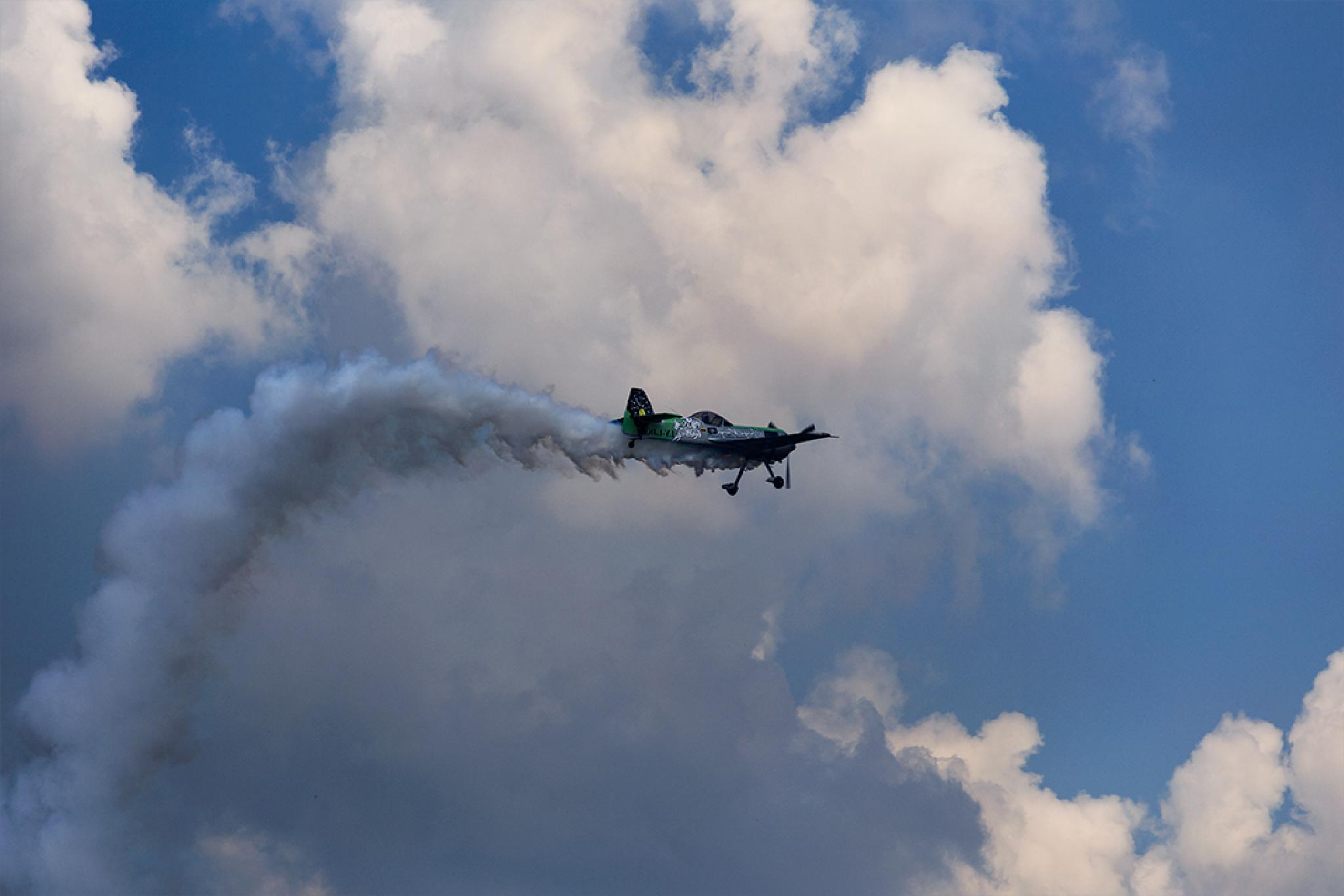 Acrobatics in the sky by Mirela Savu