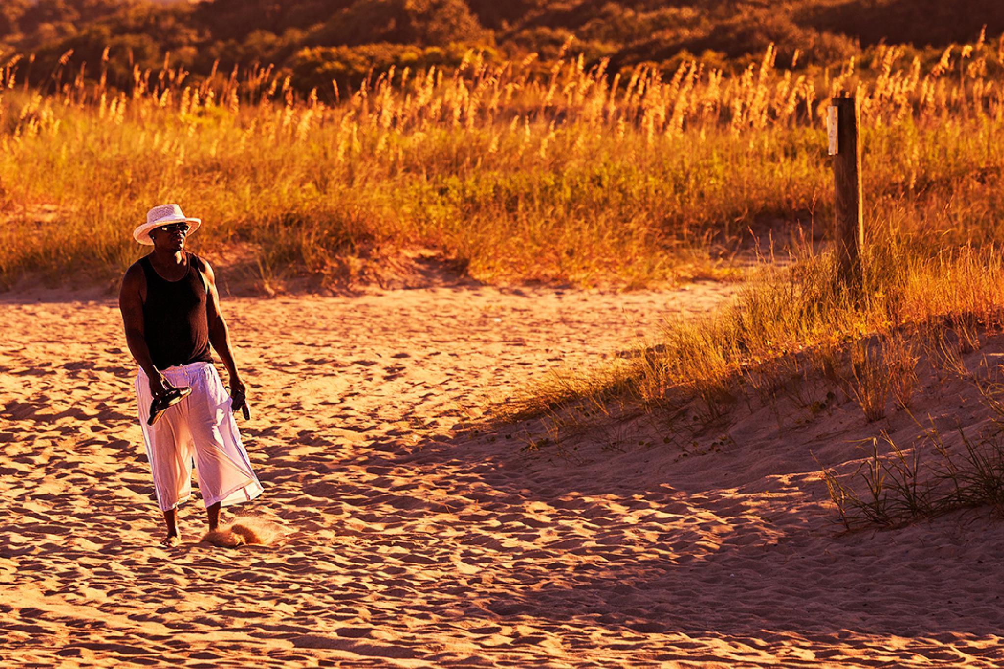 Walking on the beach at sunset by Mirela Savu