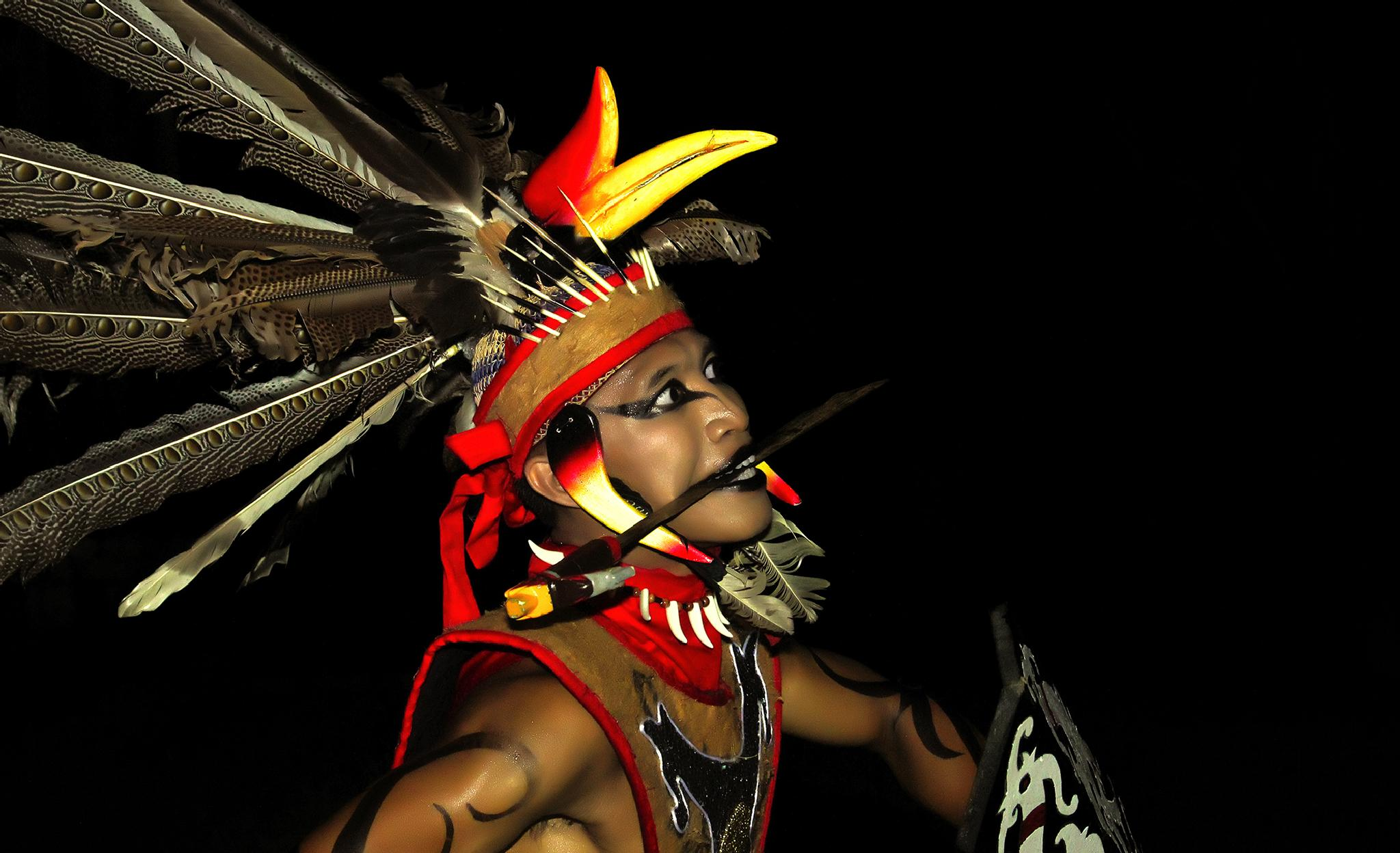 MAN OF THE DAYAK TRADITIONAL DANCE by Jukhie Damak