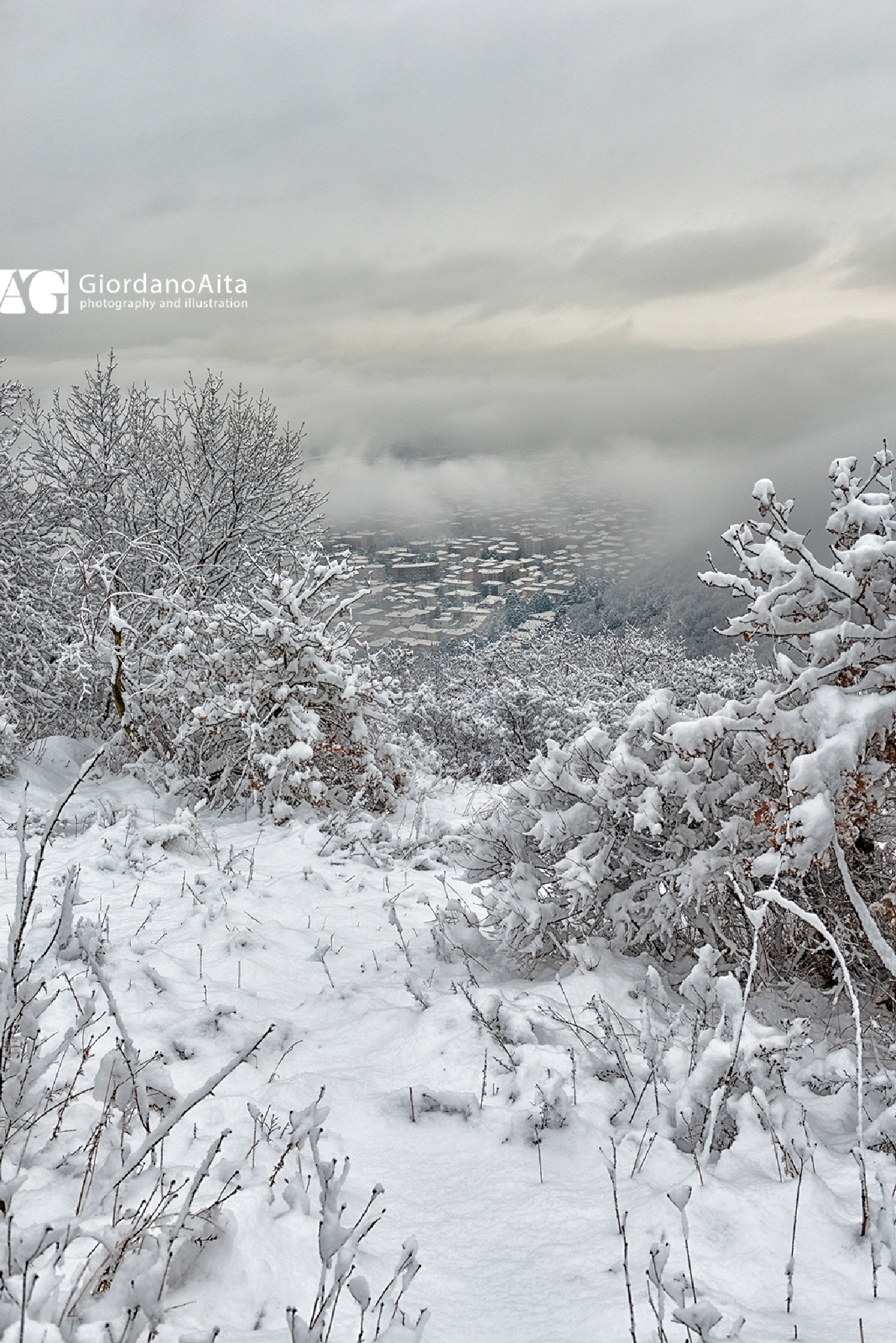 The town between snow and clouds by GiordanoAita