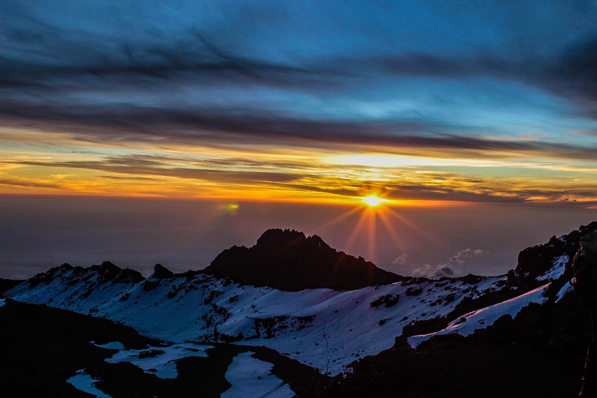 sunrise view from kilimanjaro peak  by ashish