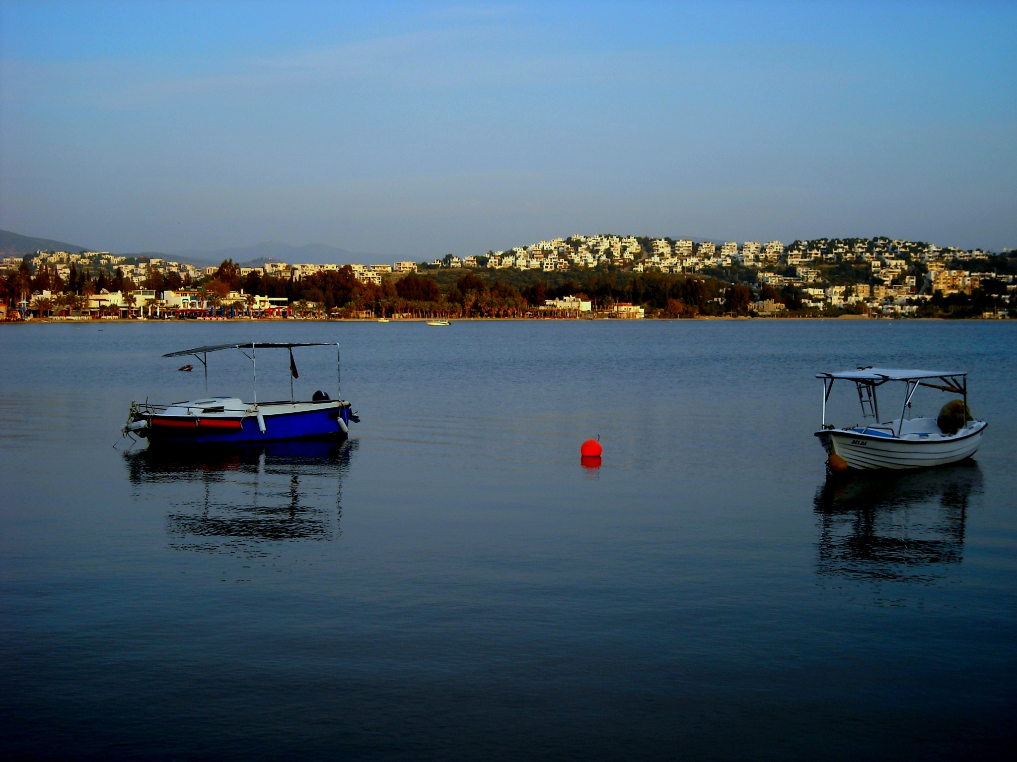 EARLY EVENING VIEW OF BITEZ BAY, BODRUM/TURKEY by Akin Saner