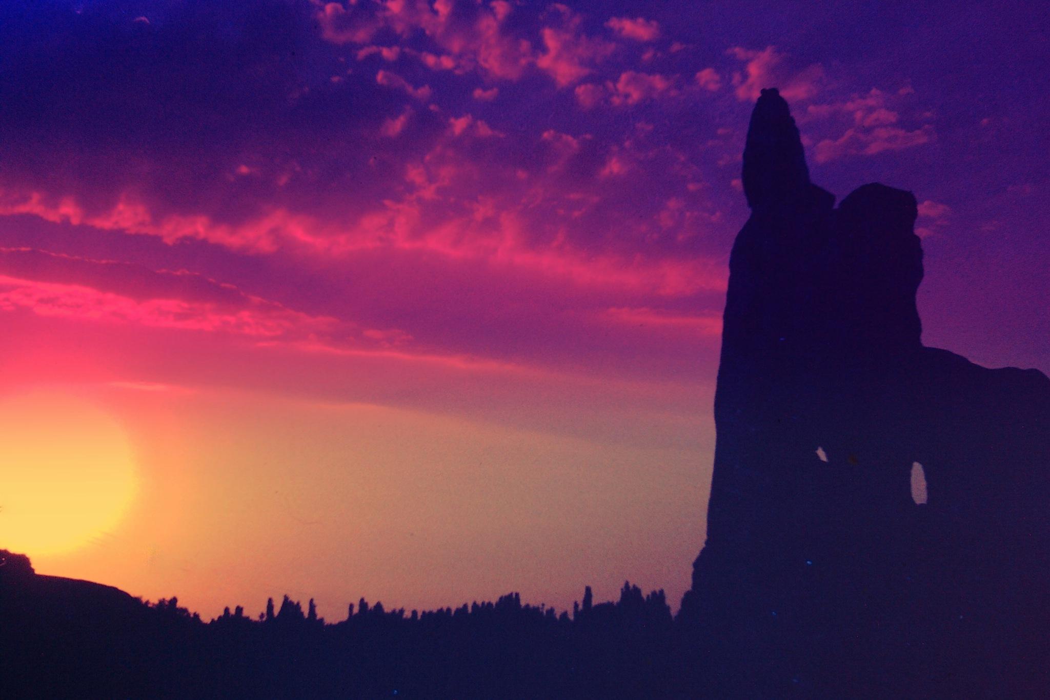 THE SUN SETS BEHIND FAIRY CHIMNEYS, CAPPADOCIA by Akin Saner