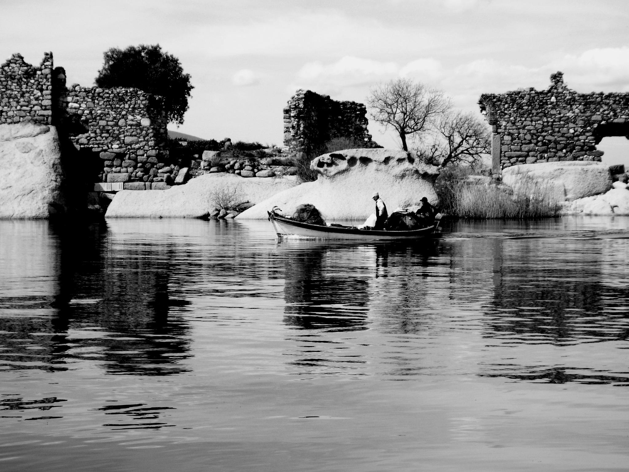 FISHERMEN GOING TO LAY THEIR NETS, BAFA LAKE B&W  by Akin Saner