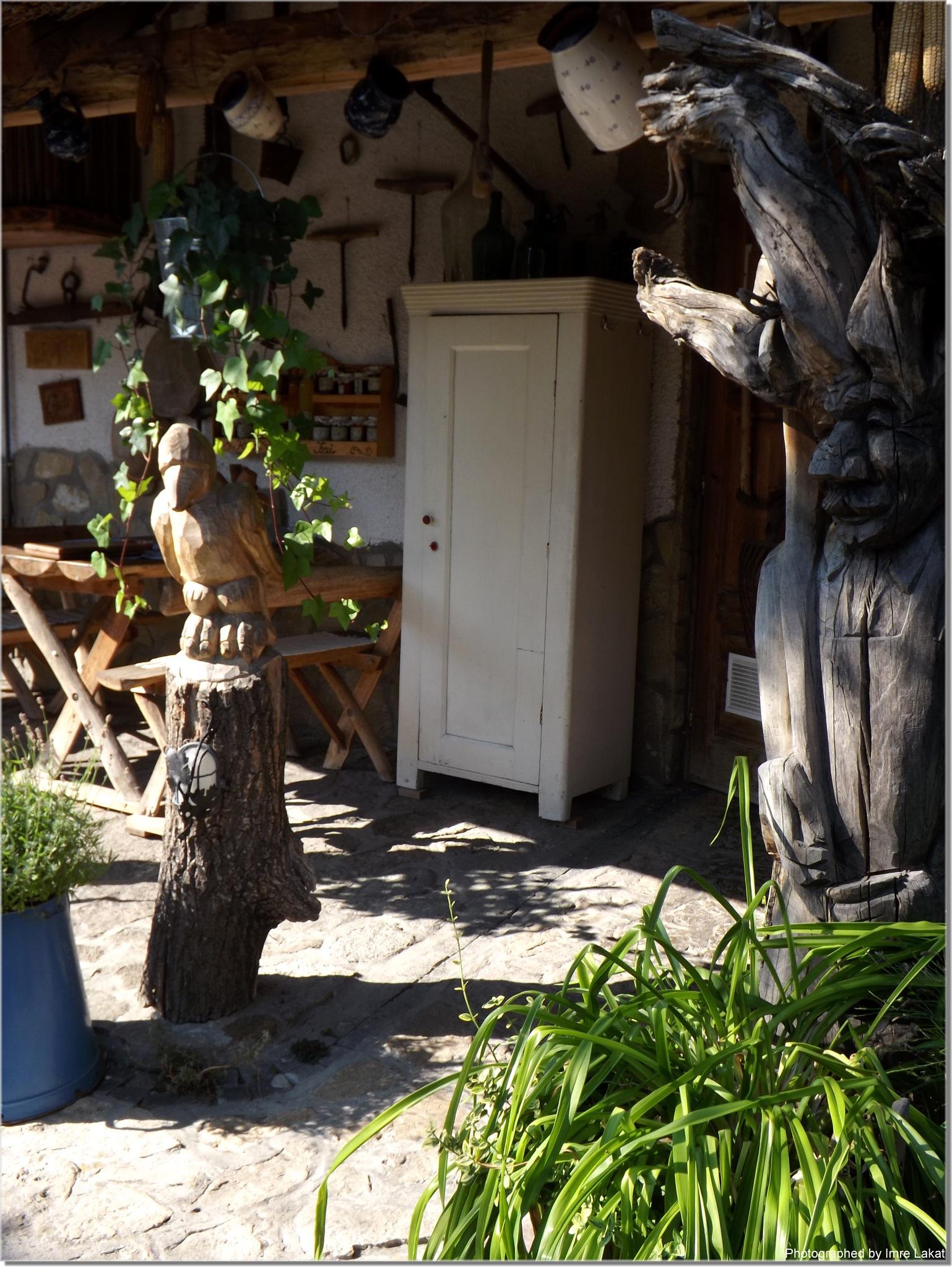 Carved wooden sculpture   .  Tihany, Régi Idők Udvara Skanzen és Étterem, Batthyány utca, Hungary by Imre Lakat