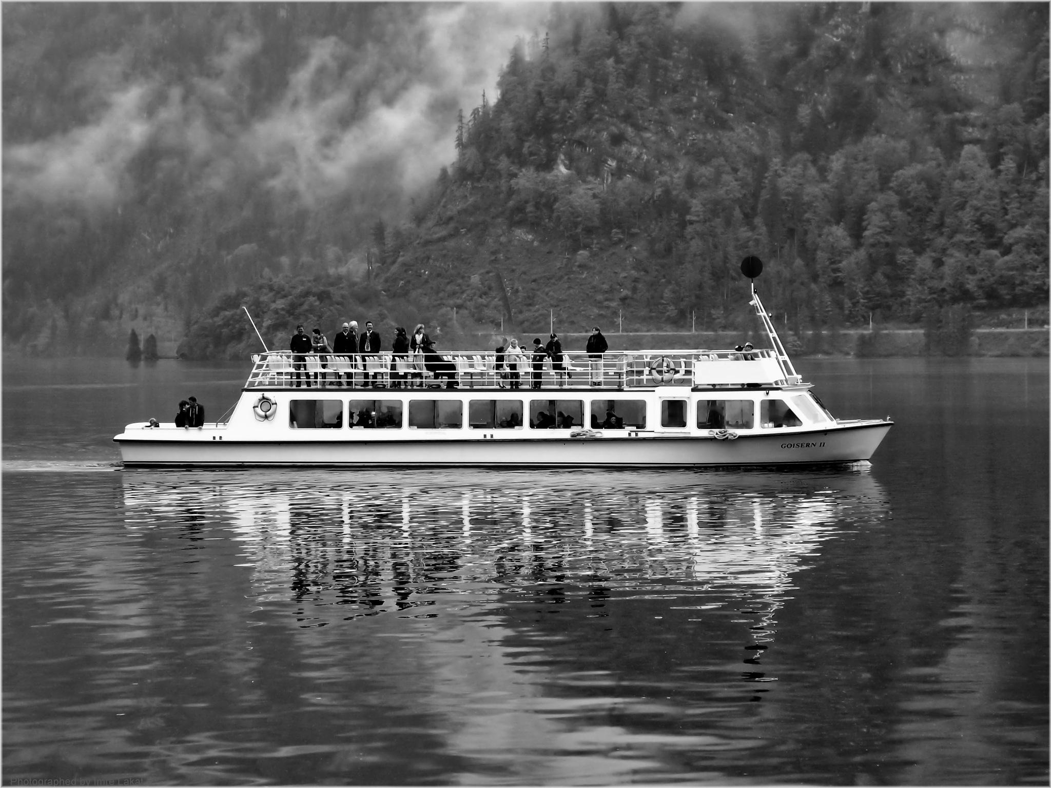 Walking boats on the Hallstatt lake  by Imre Lakat