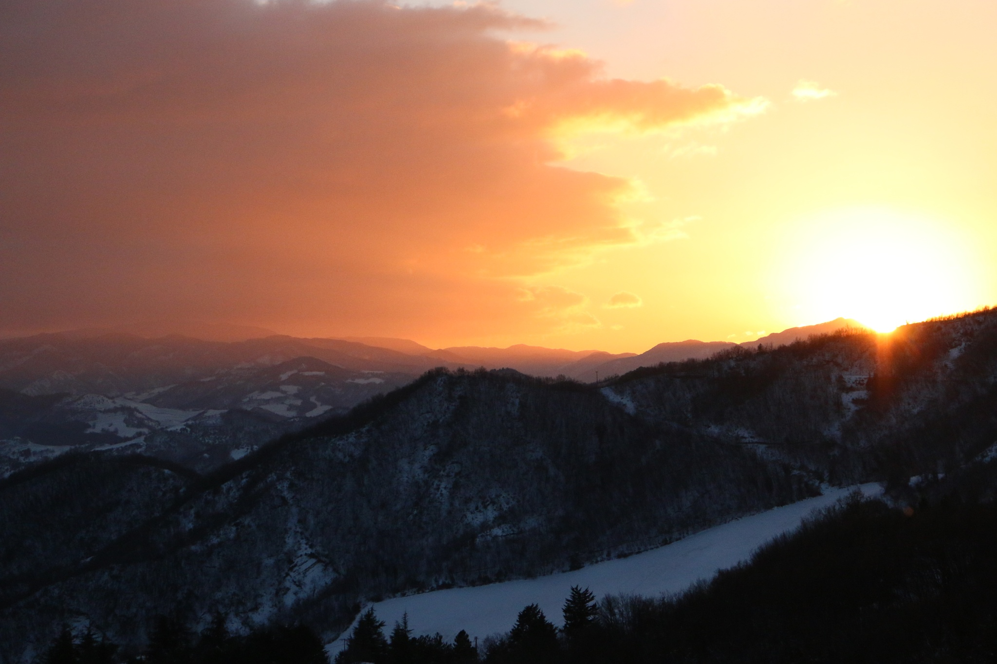Sunset in the snow by giuseppe molinari
