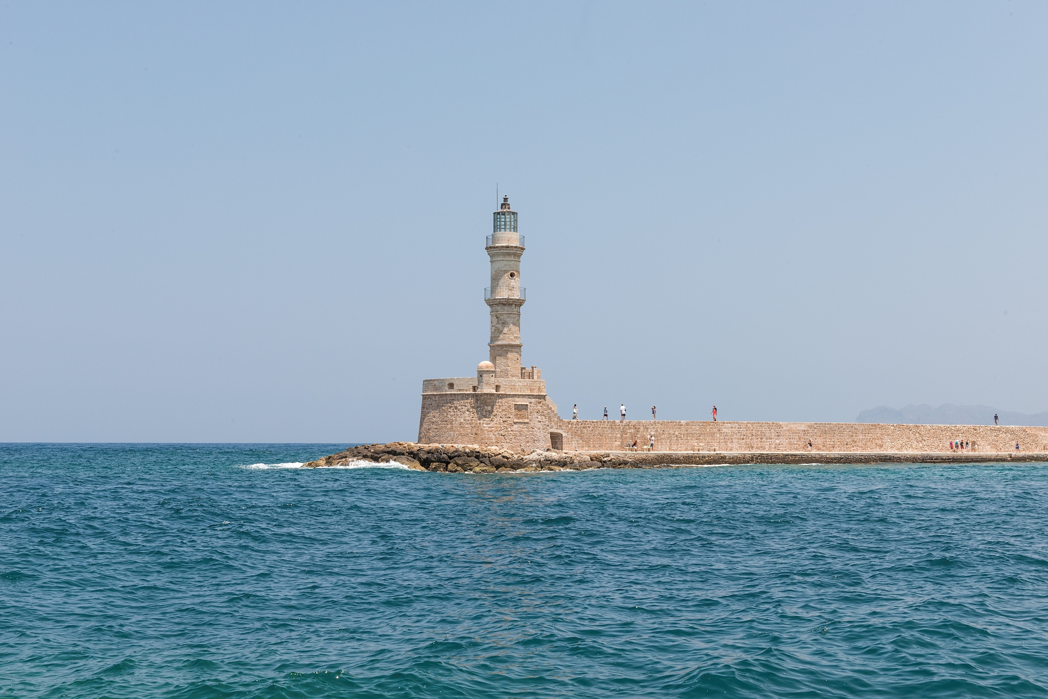 Chania Lighthouse at the port by Carlos Aranguiz