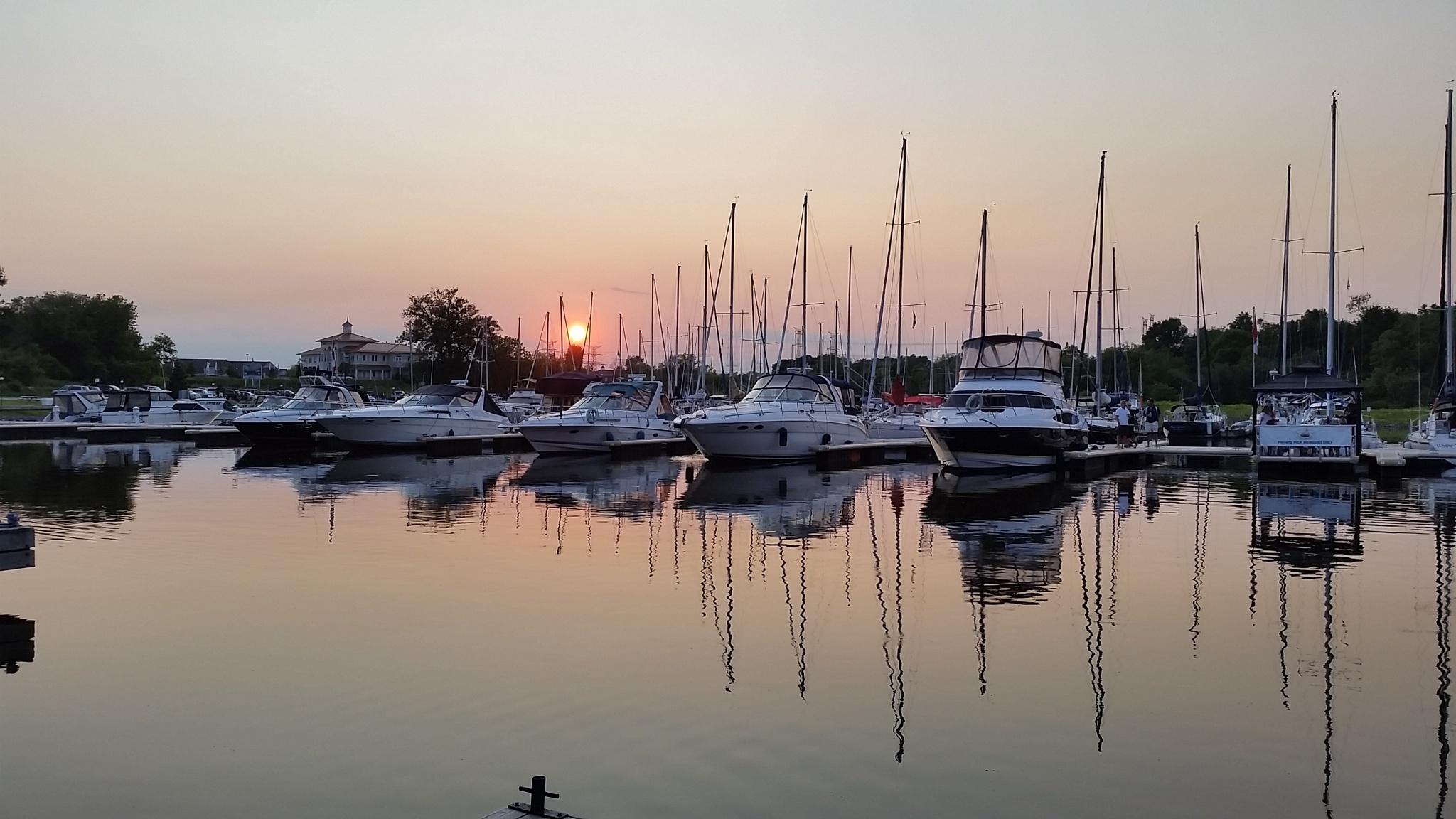 Sunset over marina by Robert Greig