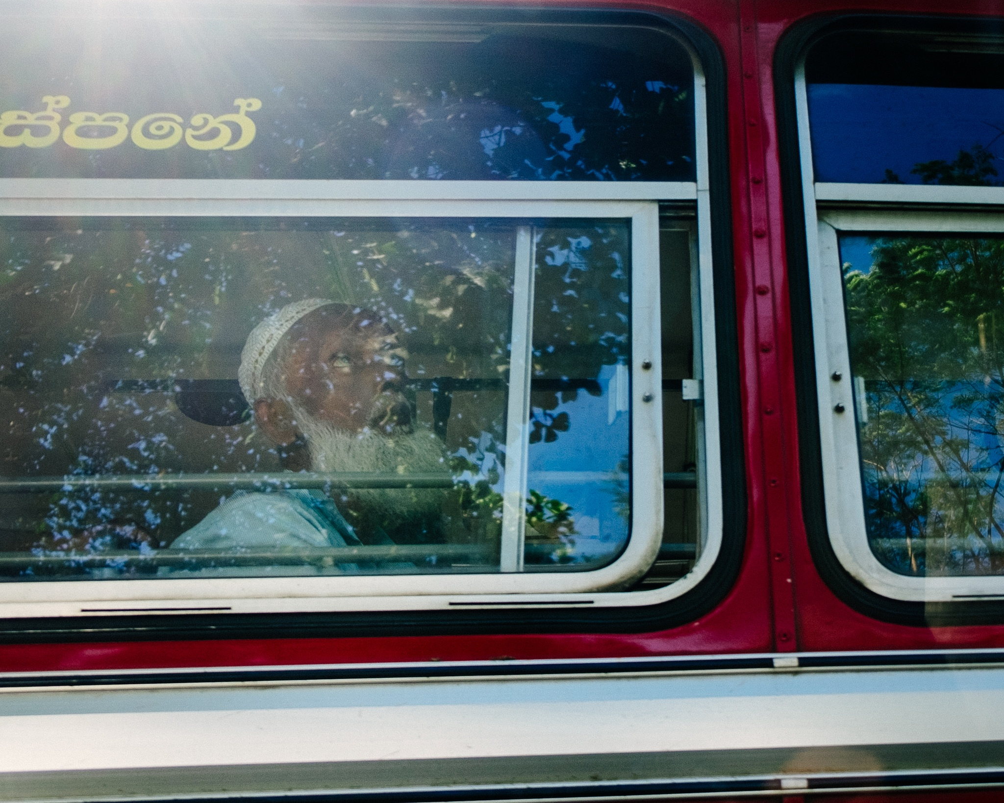 Man on state bus Kandy by Scott Raw