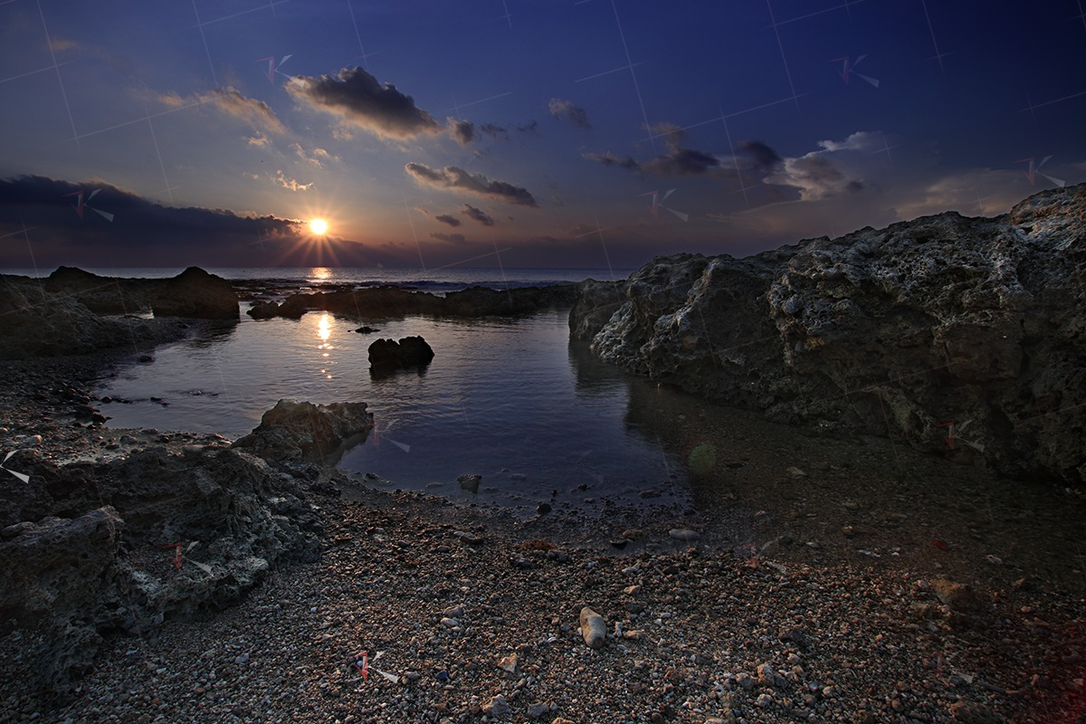 Coral reef sunset by Jovian Ke