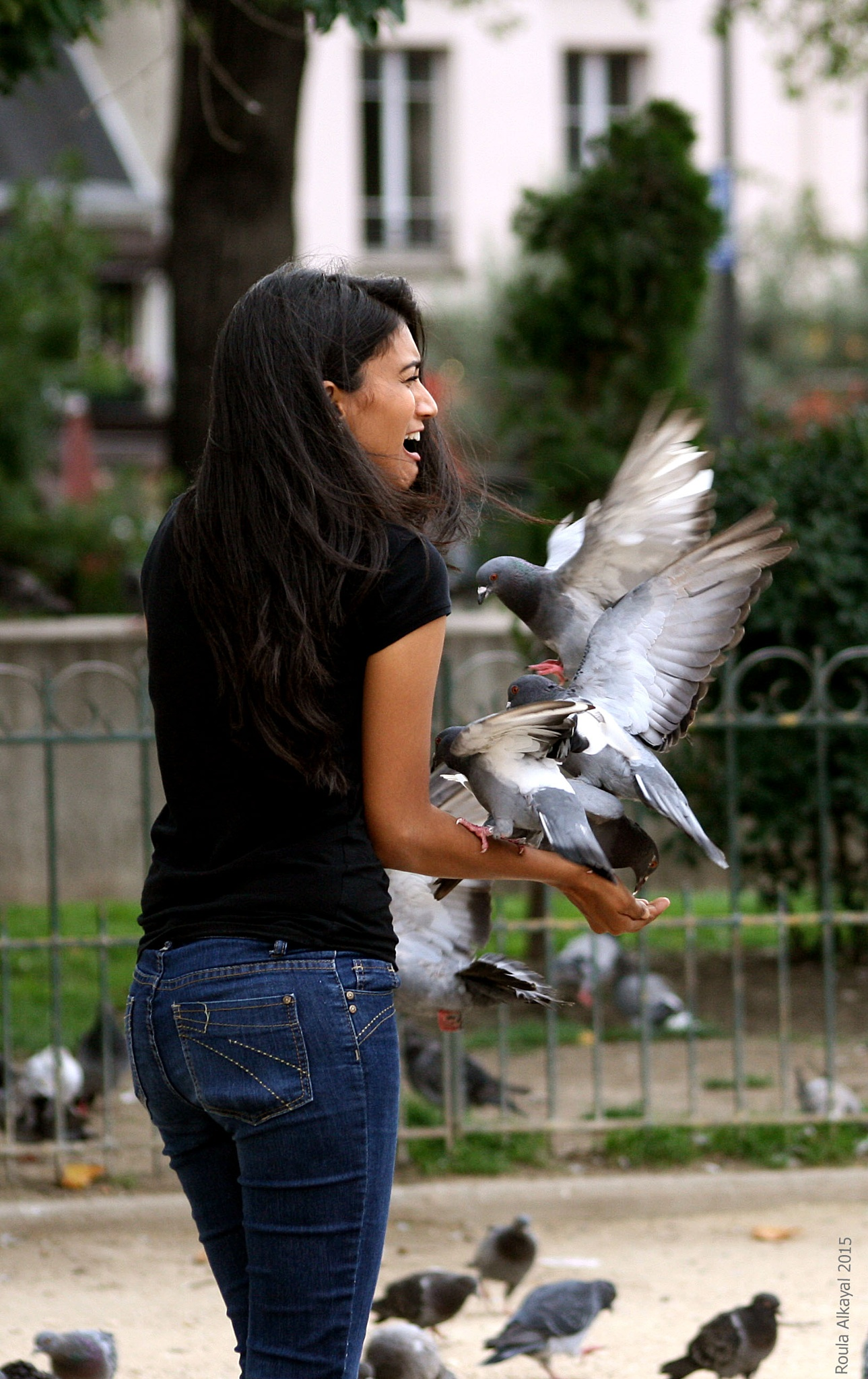 girl with a bird by Roula Kayal